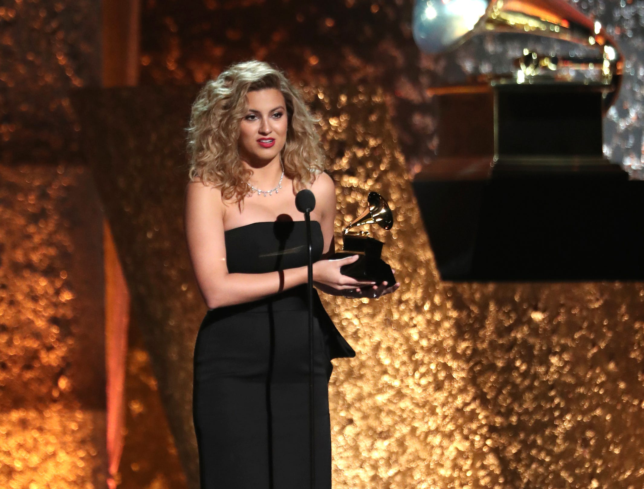 "Tori Kelly accepts the award for best gospel performance/song for ""Never Alone"" at the 61st annual Grammy Awards."