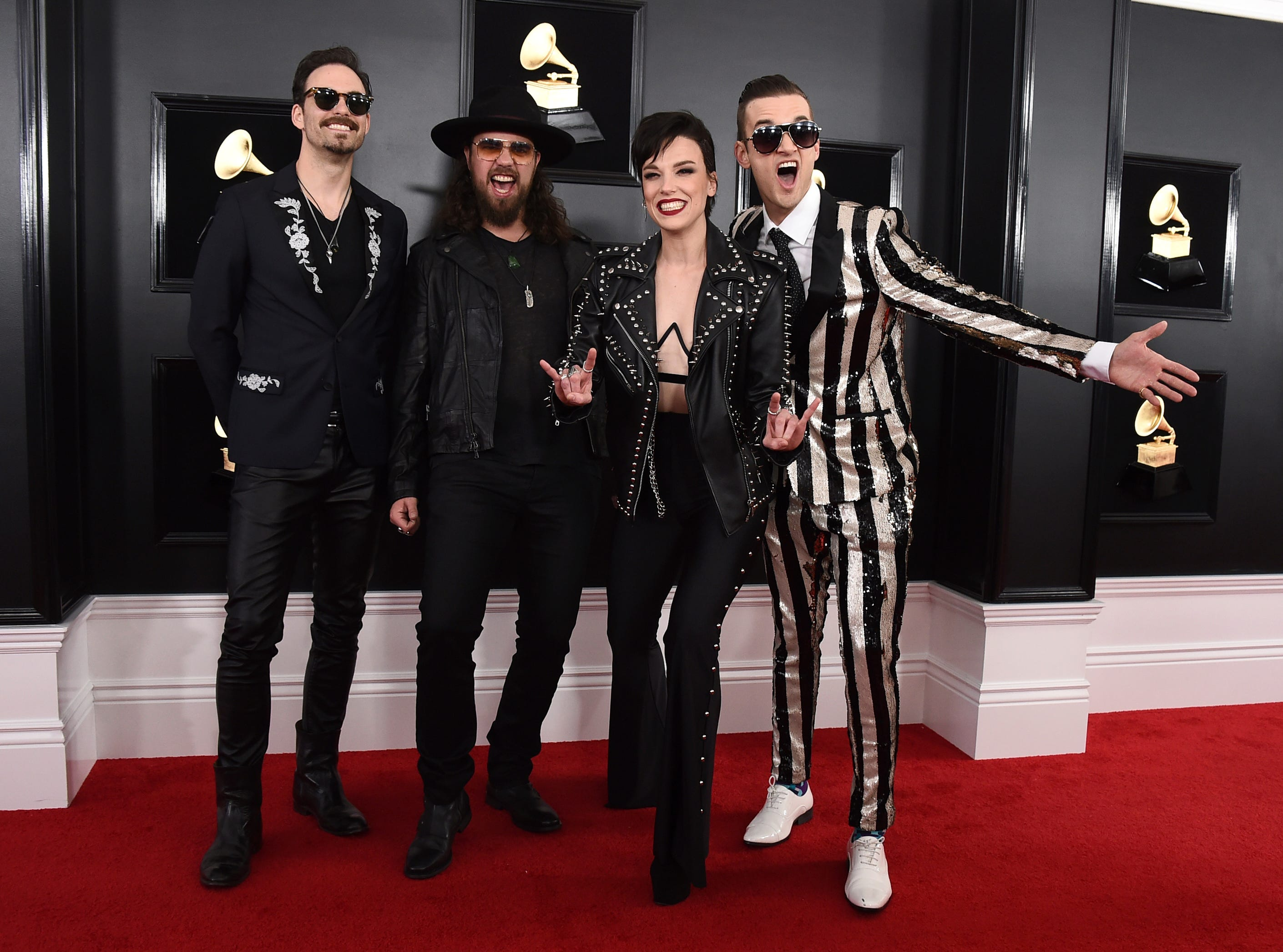 Josh Smith, from left, Joe Hottinger, Lzzy Hale, and Arejay Hale of Halestorm arrive at the 61st annual Grammy Awards.