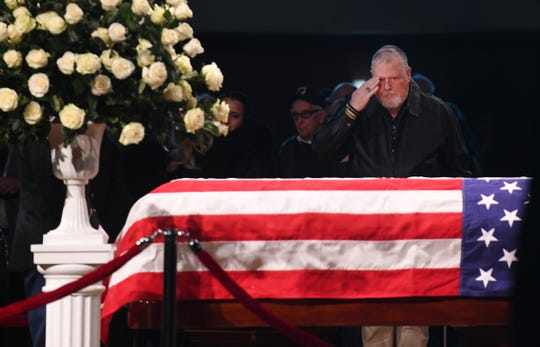 "U.S. Army Ranger Craig Tillman, a Vietnam veteran, salutes the casket of retired U.S. Rep.  John D. Dingell, ""He was a good man. He did a lot of good things for the city of Dearborn and the people he represented."""