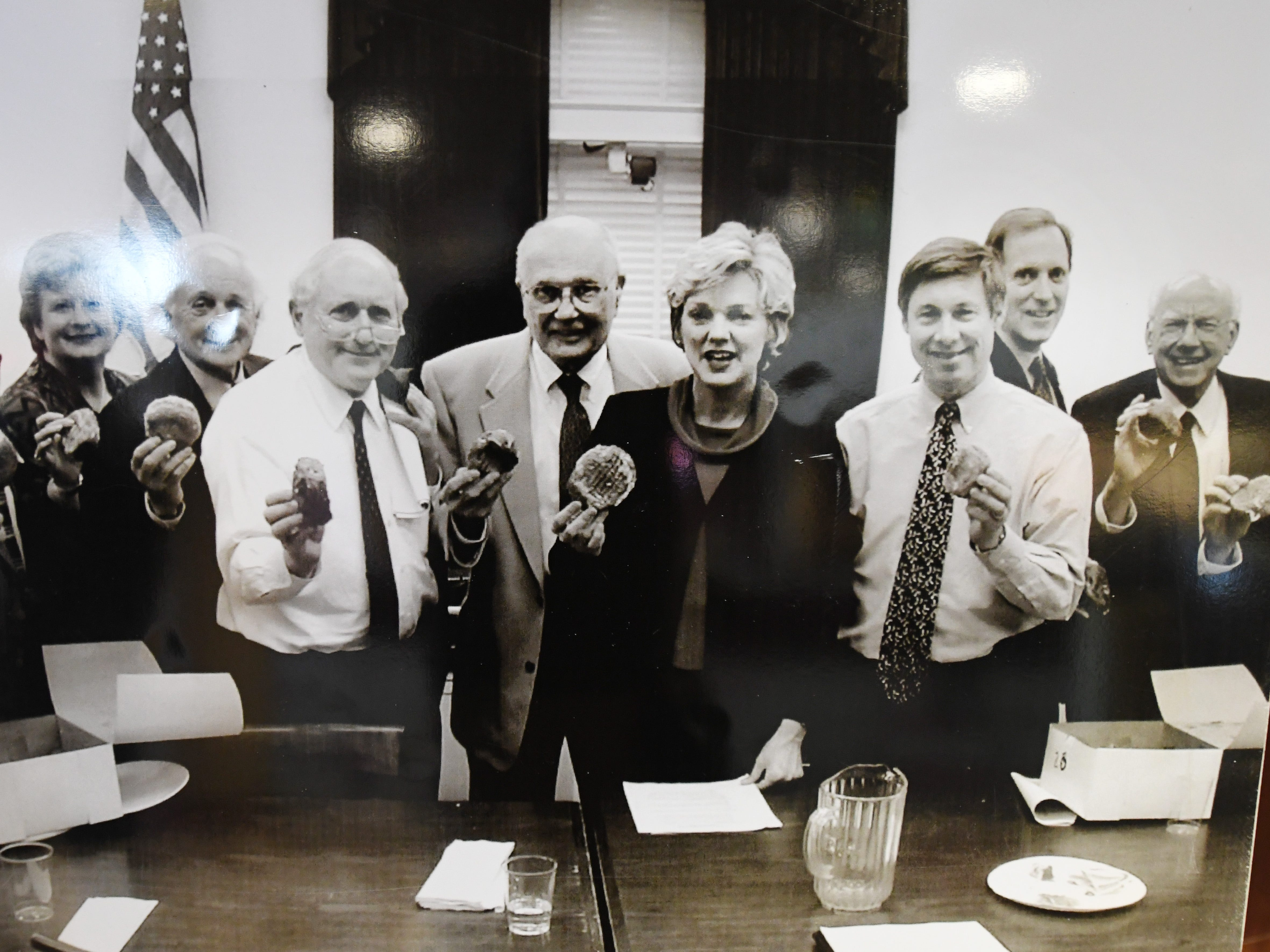John Dingell stands just behind Michigan Gov. Jennifer Granholm, center, with other members of Michigan's congressional delegation, circa 2003.