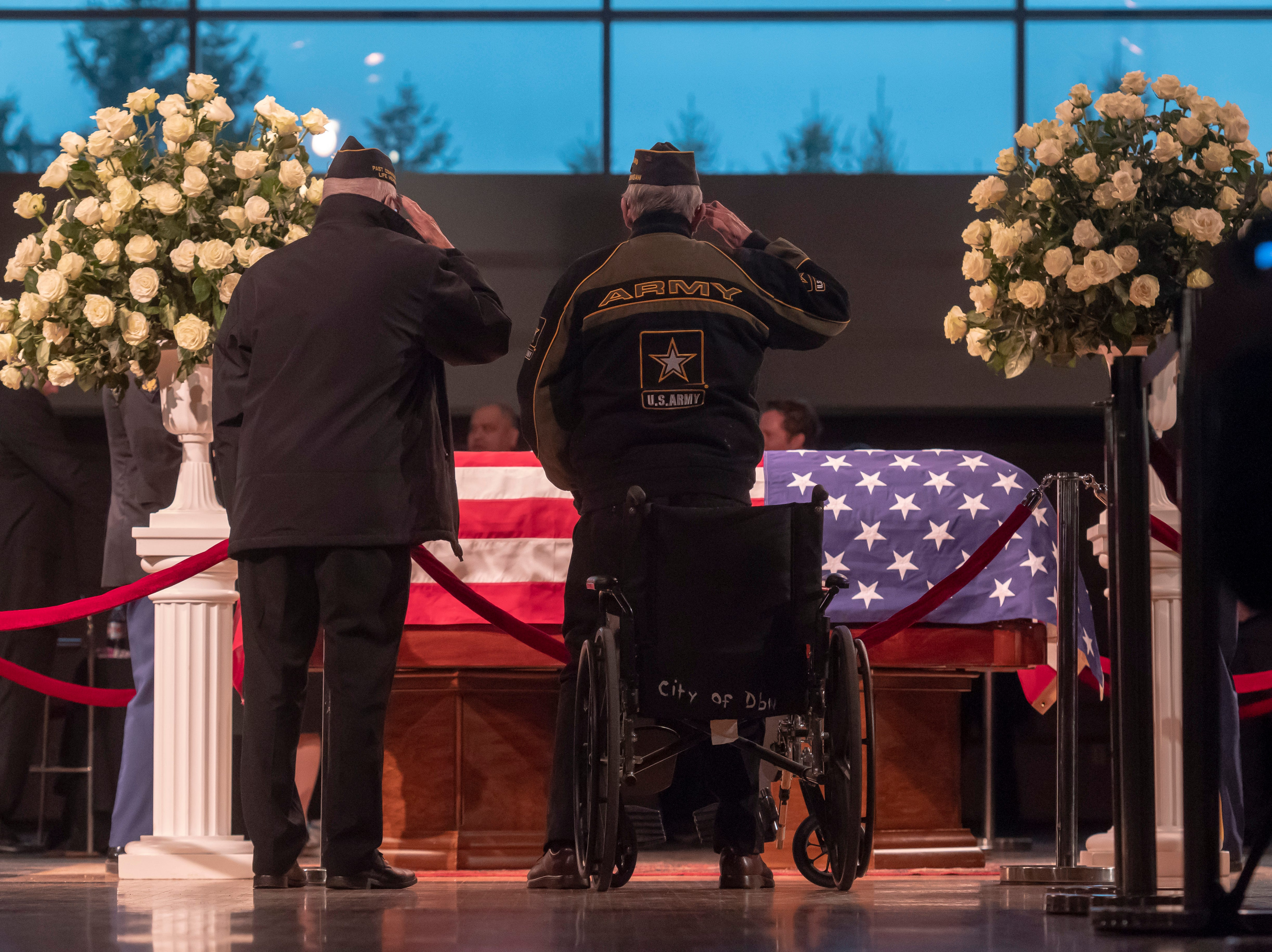 Members of the American Legion Ford Dearborn Post 364 salute the casket of former U.S. Rep. John Dingell.