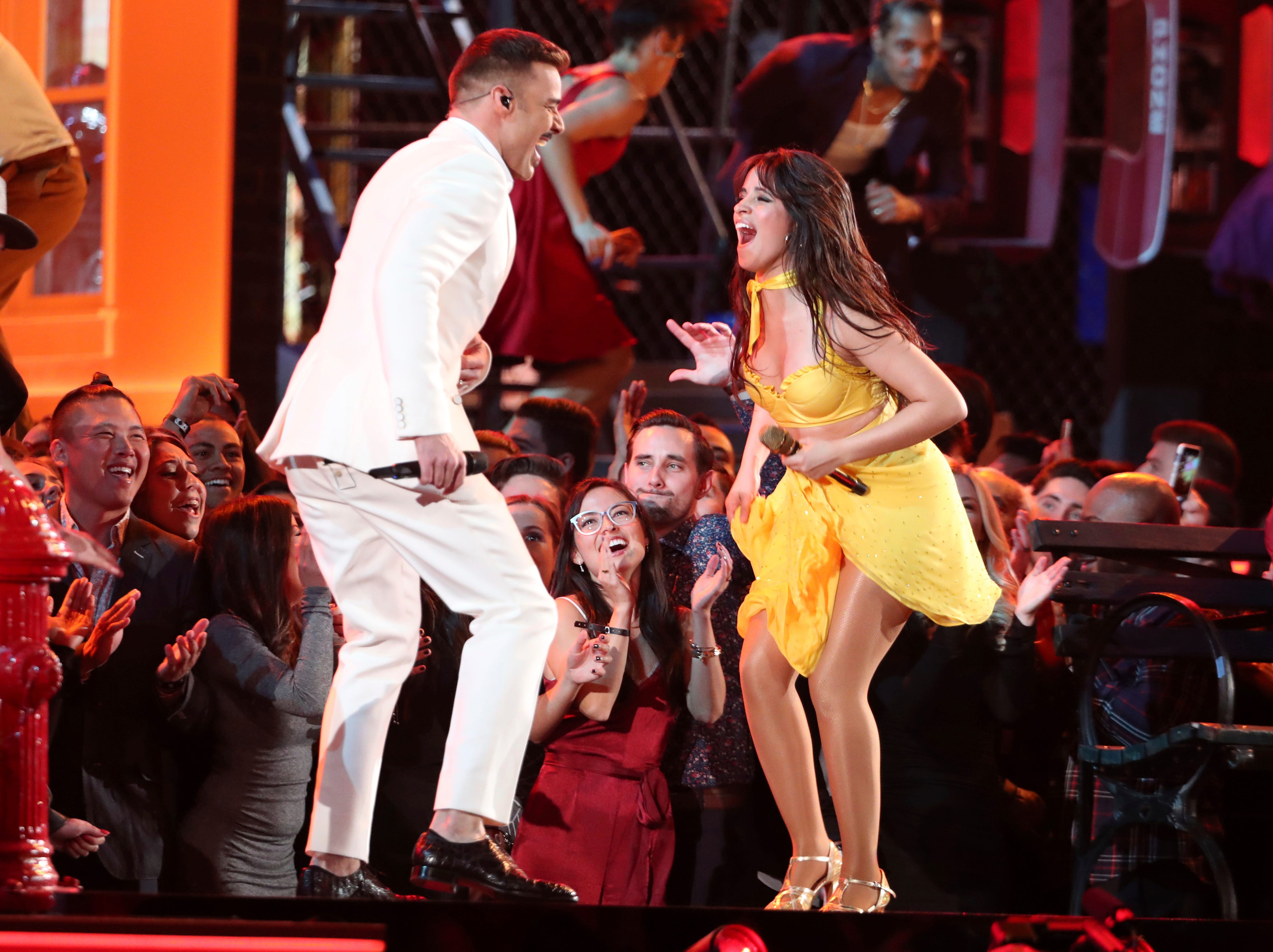 "Ricky Martin, left, and Camila Cabello perform ""Havana"" at the 61st annual Grammy Awards."