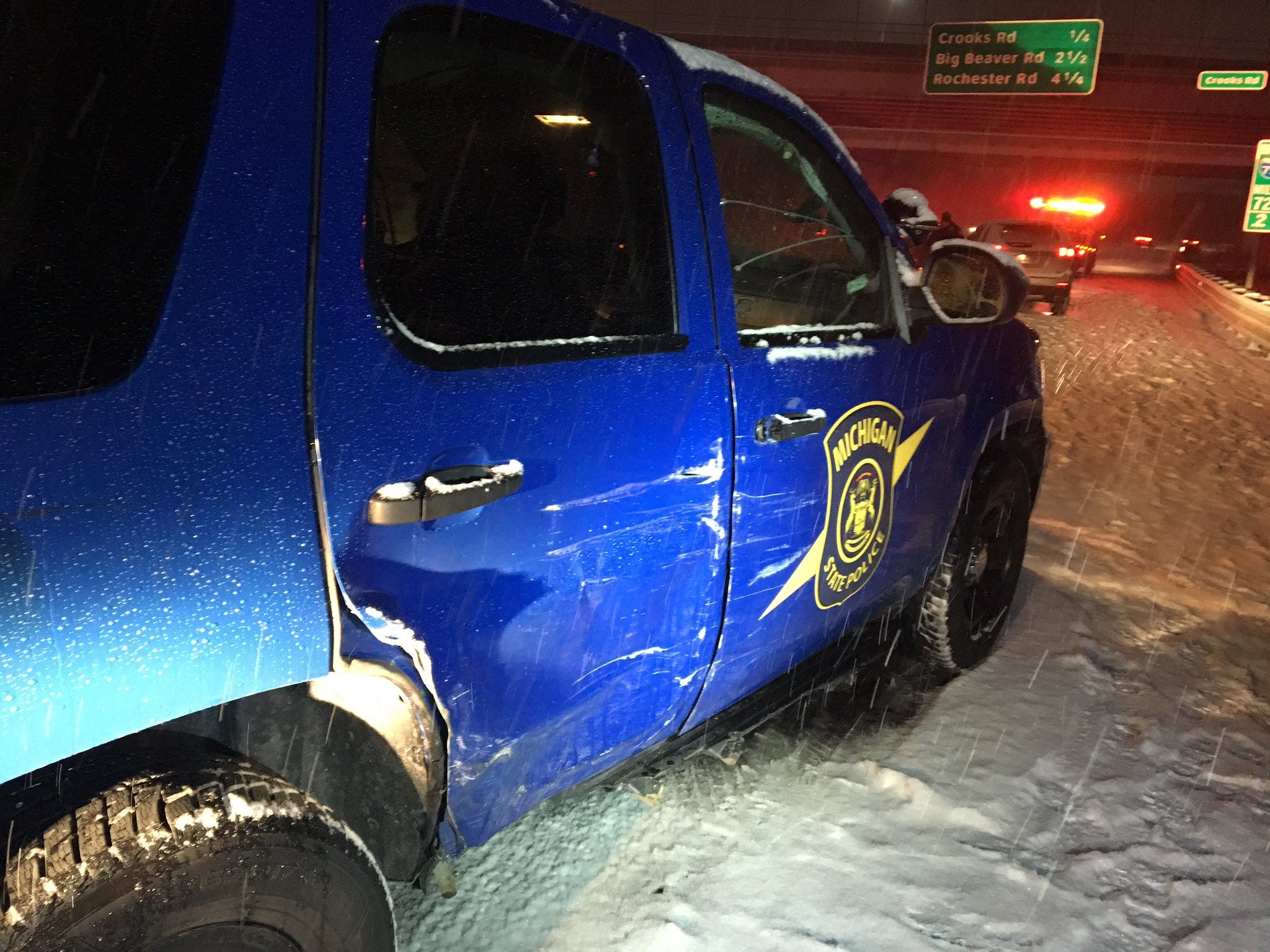 A Michigan State Police vehicle was sideswiped while officers worked a multi-car accident on I-75 near Crooks Road Sunday night.