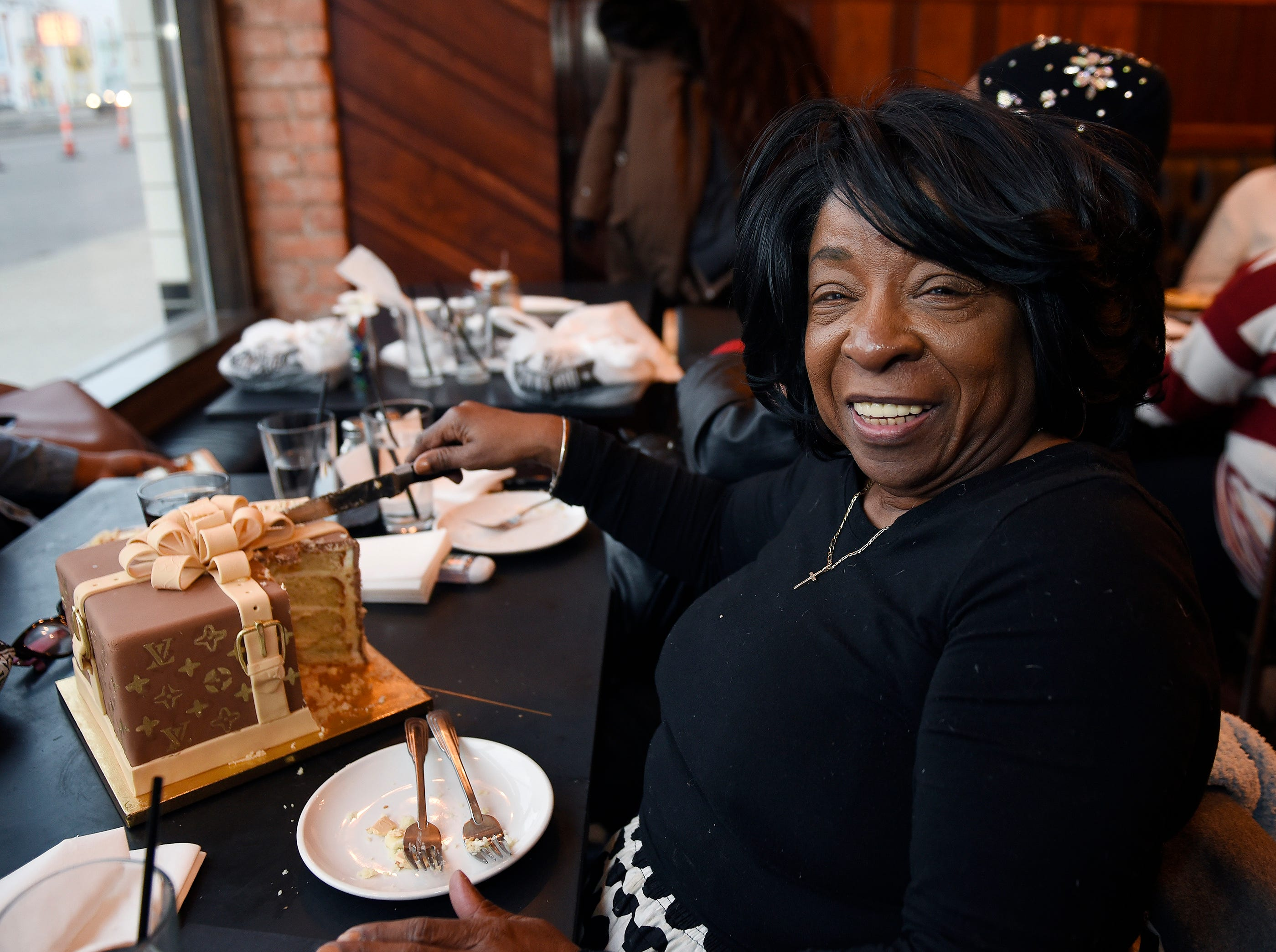 Ilene Mayweather, of Detroit, enjoys her birthday cake on her special day.