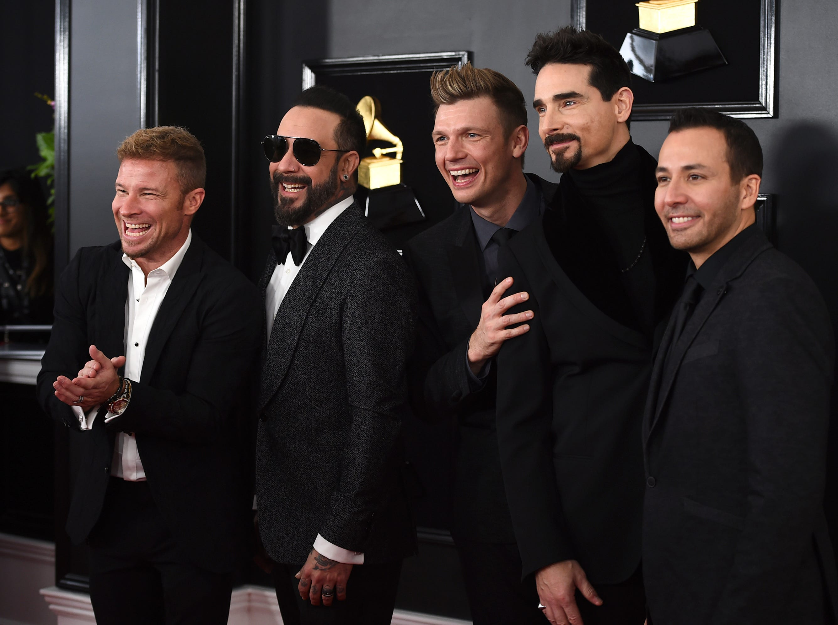 Brian Littrell, from left, AJ McLean, Nick Carter, Kevin Richardson, and Howie Dorough of The Backstreet Boys arrive at the 61st annual Grammy Awards.
