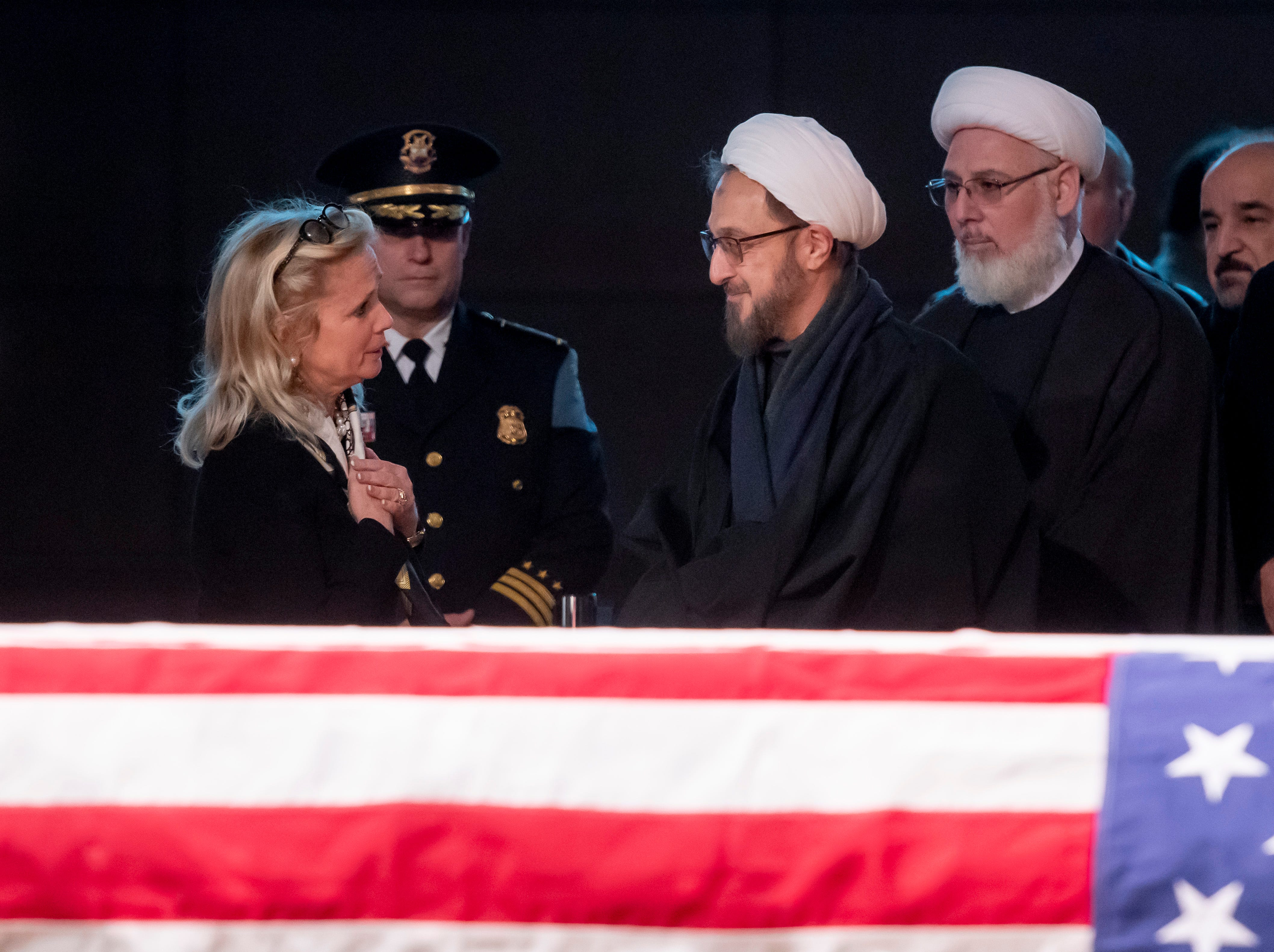 (From left) U.S. Representative Debbie Dingell receives condolences from Imams Ibrahim Kazerooni and Ahmad Hammoud, from the Islamic Center of America, during a visitation for her husband, former U.S. Rep. John Dingell.