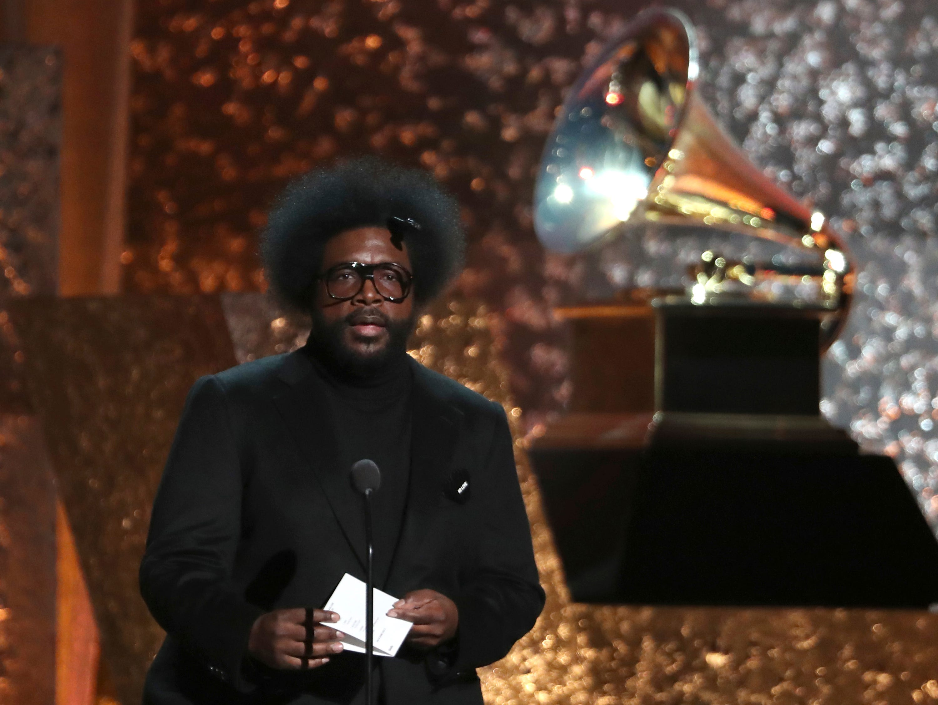 Questlove presents an award at the 61st annual Grammy Awards.
