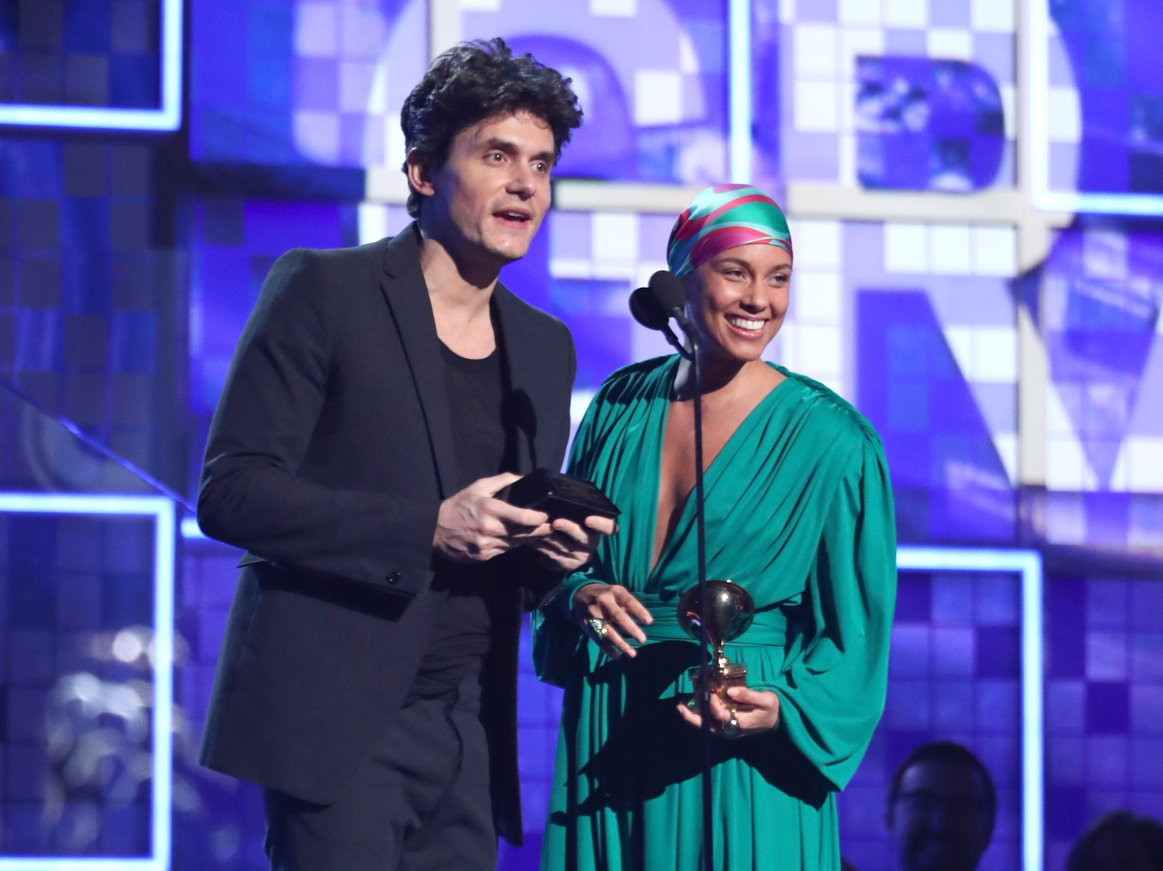 John Mayer, left, and Alicia Keys present the award for song of the year at the 61st annual Grammy Awards.