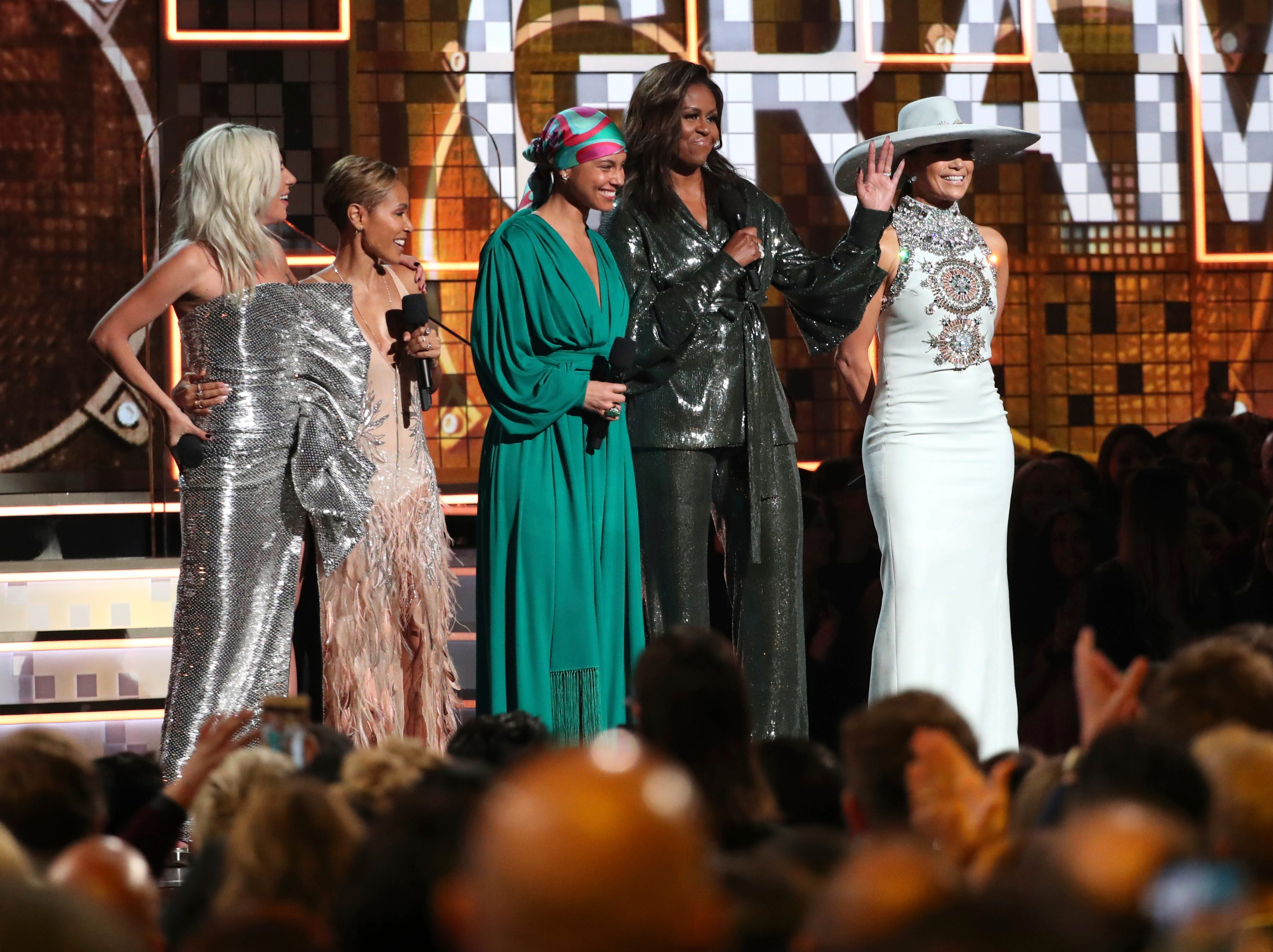 Lady Gaga, from left, Jada Pinkett Smith, Alicia Keys, Michelle Obama and Jennifer Lopez speak at the 61st annual Grammy Awards on Sunday.