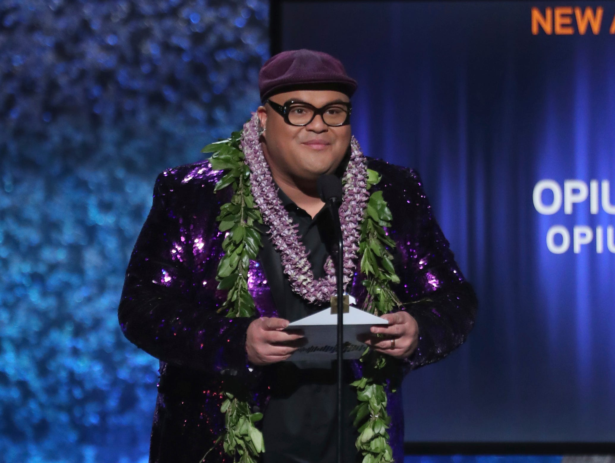 Kalani Pe'a presents an award at the 61st annual Grammy Awards.