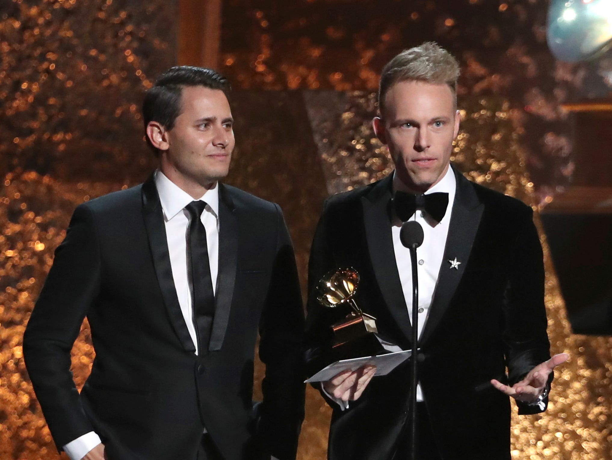 "Benj Pasek, left, and Justin Paul accept the award for compilation soundtrack for visual media for ""The Greatest Showman"" at the 61st annual Grammy Awards."