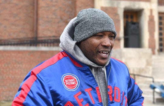 "Aaron Salter distributes food outside the Body of Christ Church in Detroit on Friday, February 8, 2019. Salter was wrongfully convicted of murder and is awaiting about $750,000 the state owes him. Salter has started a program called  ""Innocence Maintained,"" which helps fellow exonerated ex-prisoners get back on their feet."
