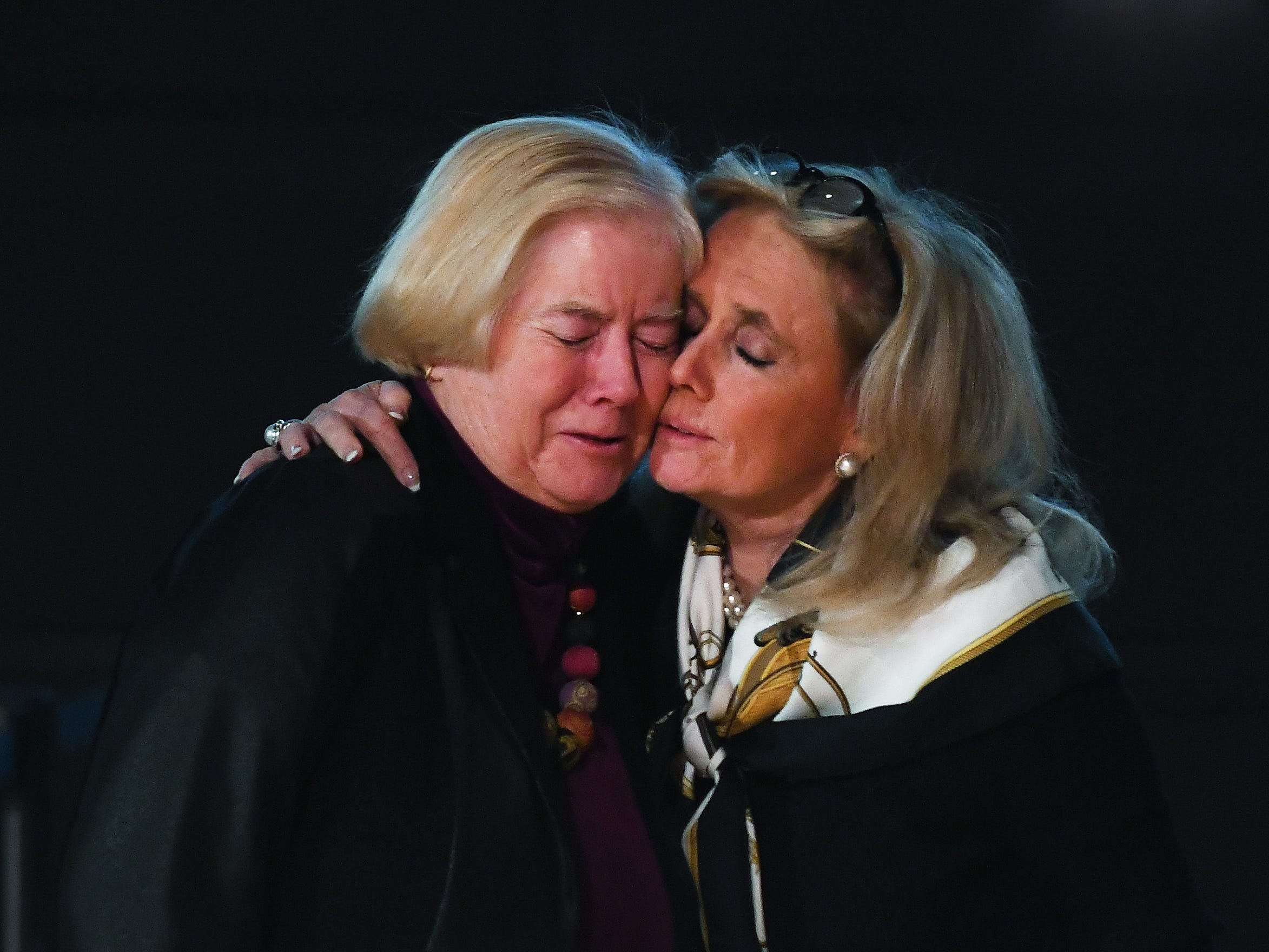 Former U.S. Rep. Candice Miller, now Macomb County public works commissioner, is hugged by U.S. Rep.  Debbie Dingell at the start of the public viewing.