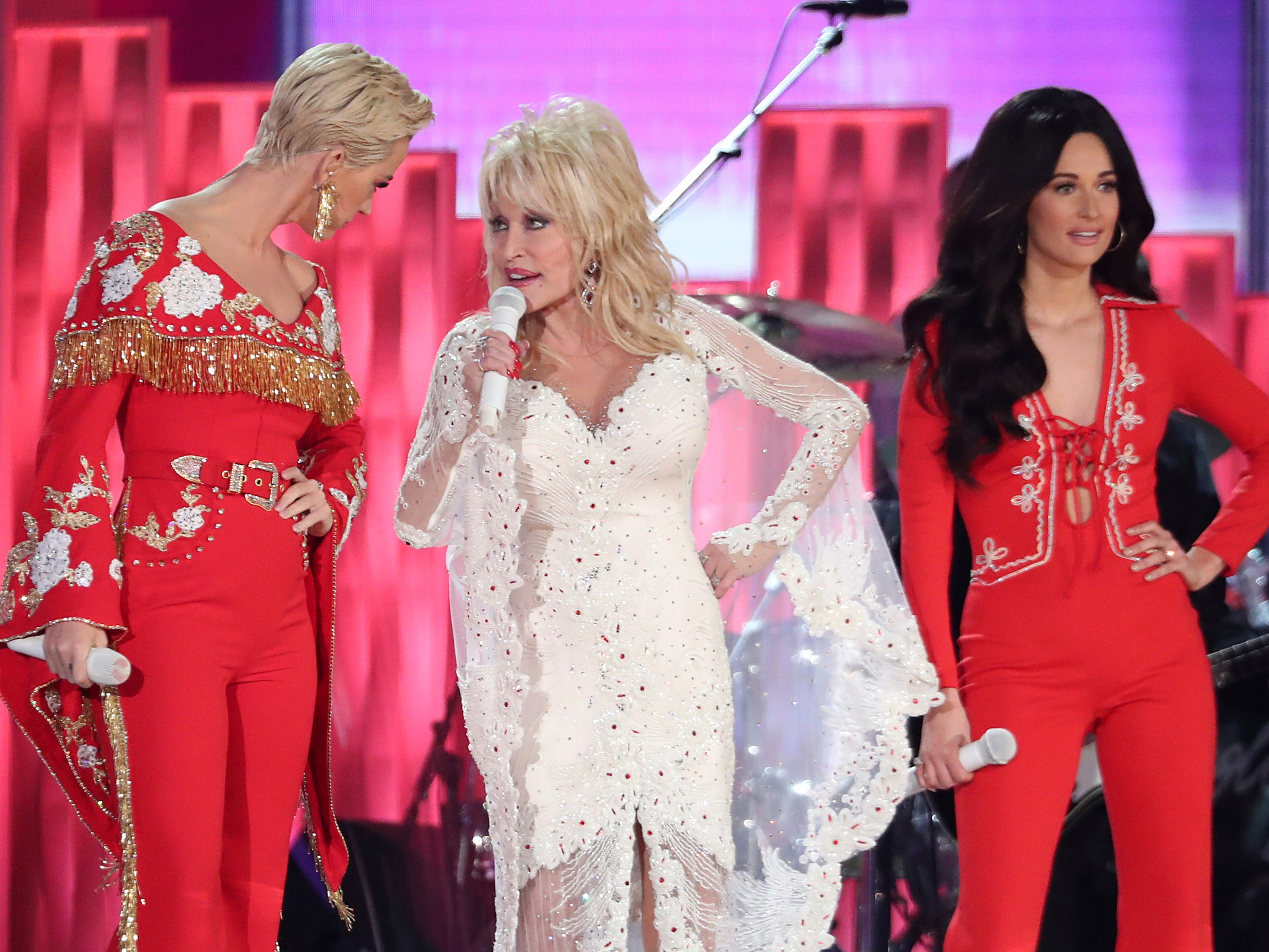 "Katy Perry, from left, Dolly Parton and Kacey Musgraves perform ""Here You Come Again"" at the 61st annual Grammy Awards."