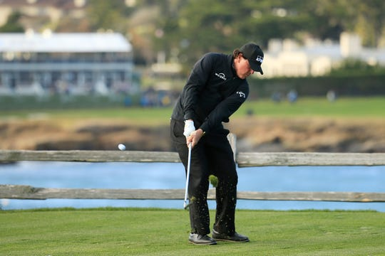 Phil Mickelson plays his shot from the seventh tee.