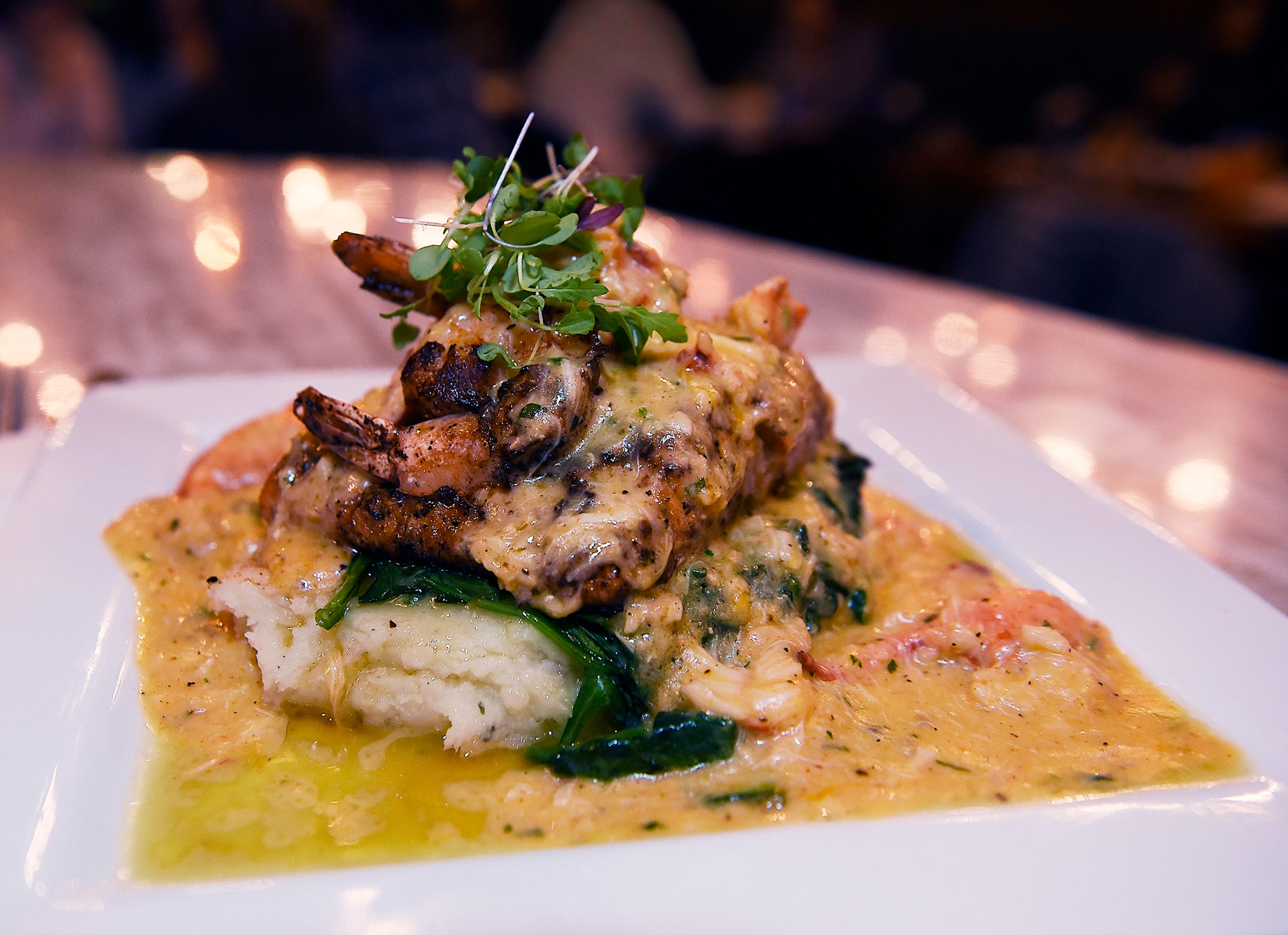 The $42 dollar Salmon Tower, (8oz organic alaskan salmon, topped with jumbo lump crab & lobster, whipped potatos, spinach with house sauce.