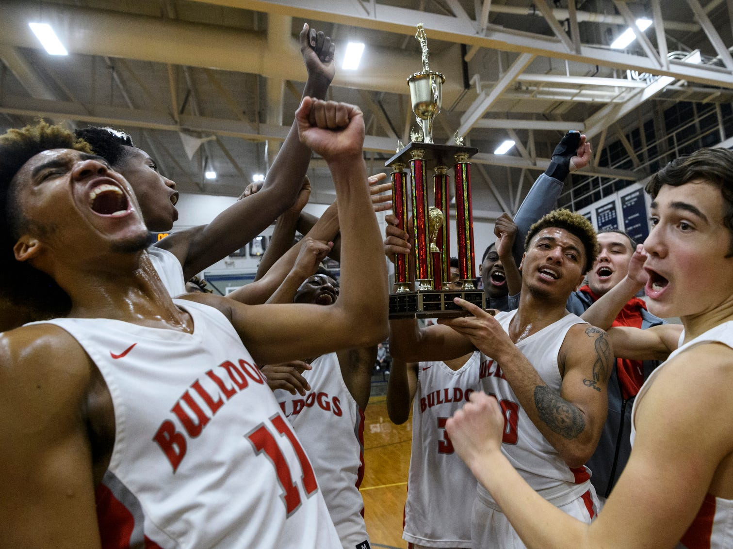 The Bosse Bulldogs won the SIAC tournament championship for the second straight season by defeating the Memorial Tigers 82-61 at Reitz High School in Evansville, Ind., Saturday, Jan. 12, 2019.