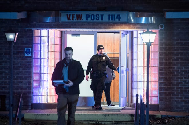 Evansville Police officers exit the VFW Post 1114, 110 N. Wabash Ave., in Evansville, Ind. after a shooting in the Bingo Hall Sunday, Jan. 13, 2019.