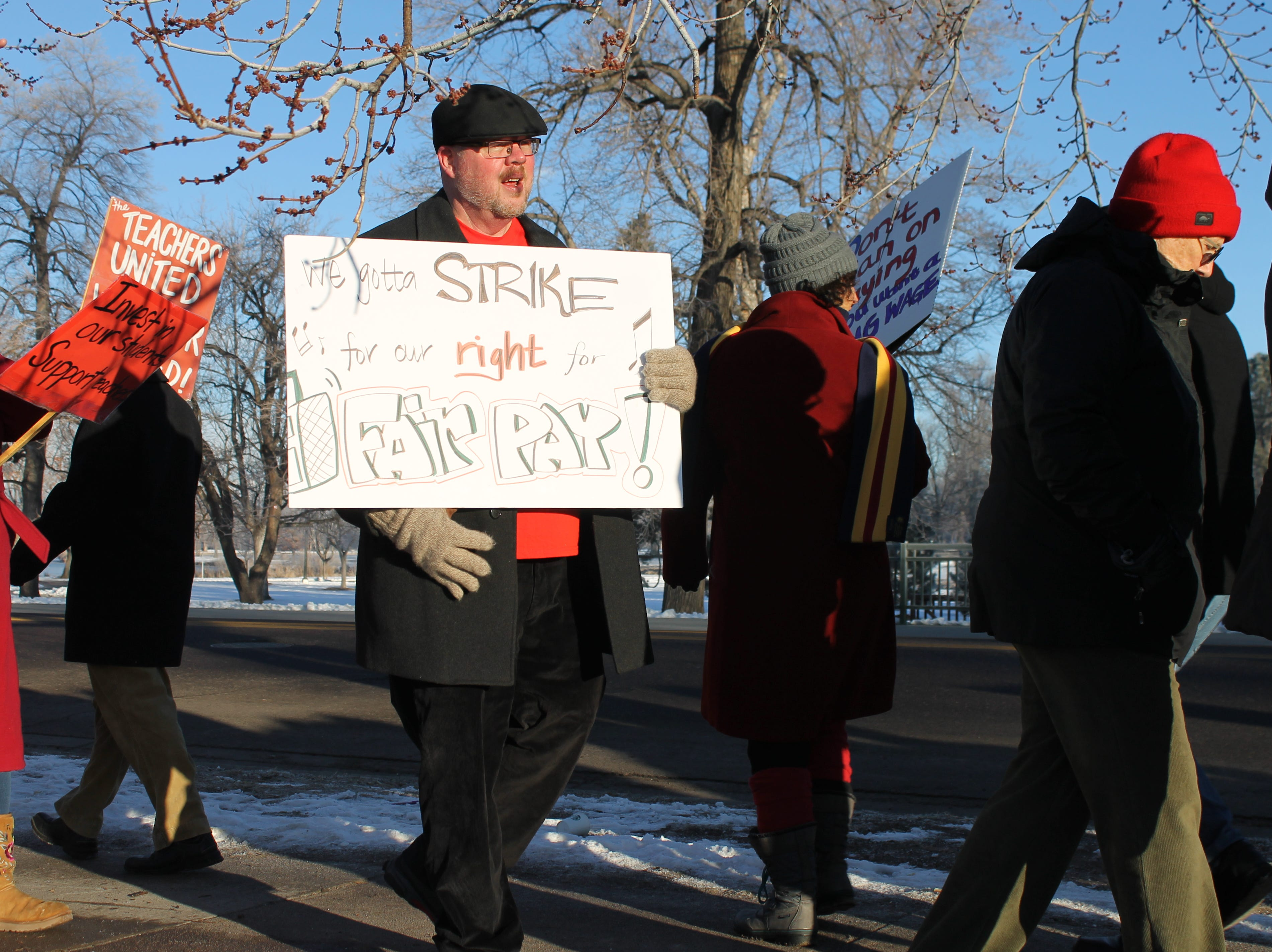 Christopher Ritchie, a teacher at South High School, marches with his fellow teachers Monday. It's the first time in 25 years Denver teachers have gone on strike. Teachers are calling for changes to the pro-comp pay system, which many say leaves them unable to predict their income in the long-term.