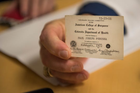 Infection preventionist Paul Poduska shows his original EMT certification card from 1972 on Friday, Feb. 8, 2019, at UCHealth Poudre Valley Hospital in Fort Collins, Colo.