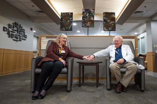 Wife and husband chief nursing officer Donna Poduska and infection preventionist Paul Poduska hold hands while having their portrait taken on Friday, Feb. 8, 2019, at UCHealth Poudre Valley Hospital in Fort Collins, Colo.
