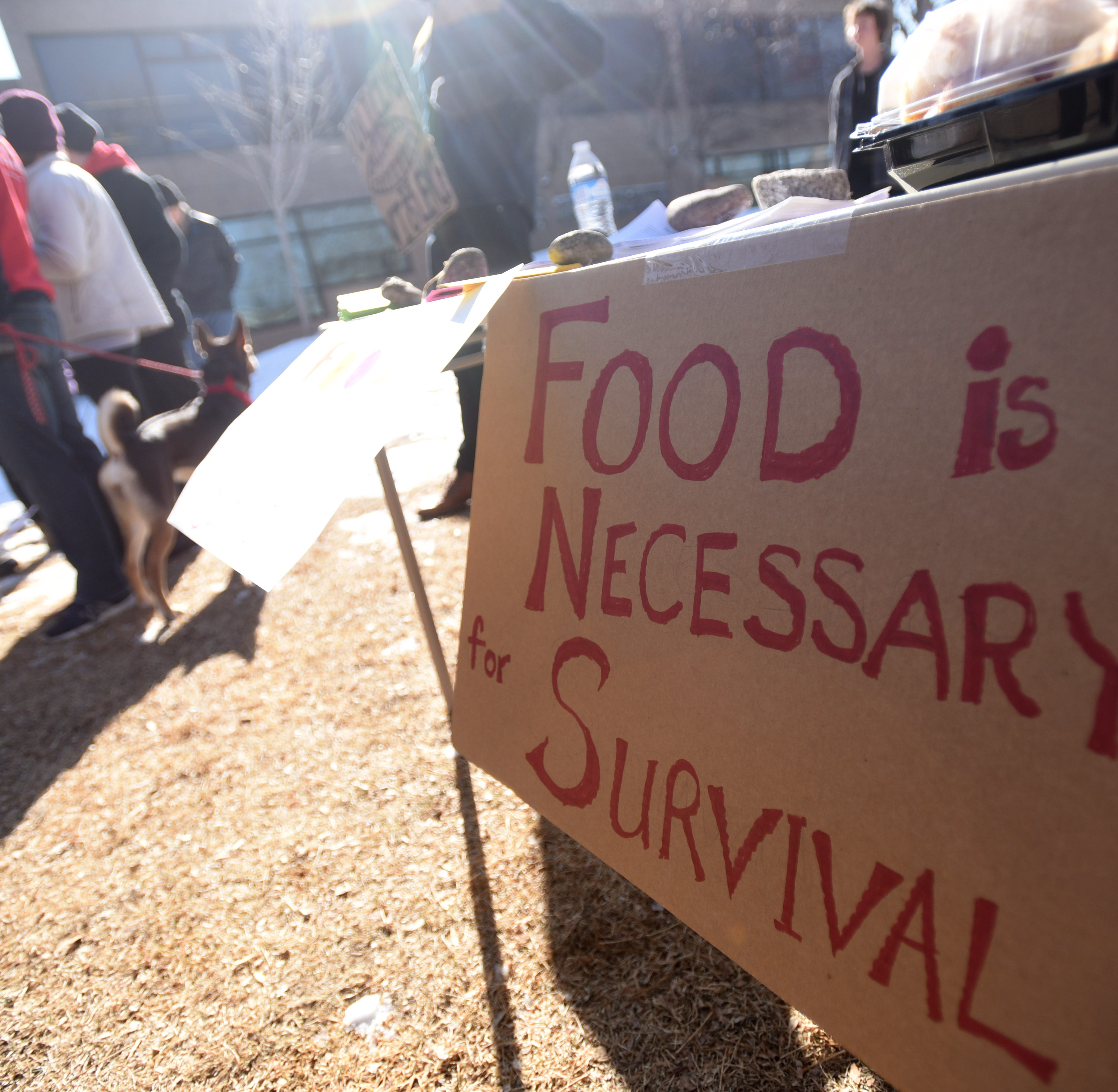 Weekly picnic for homeless is shut down in Library Park, leading to rally and uncertain future