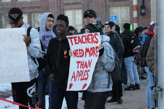 A South High School student holds up a sign Monday to support teachers' demand for better pay. Denver Public Schools teachers went on strike for the first time 25 years.