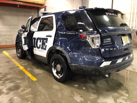 An Ashwaubenon Public Safety officer's cruiser was struck by a semi Monday morning.