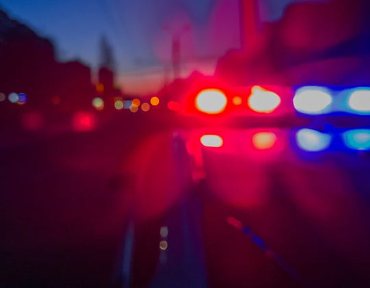 Red and blue Lights of police car in night time. Night patrolling the city. Abstract blurry image.