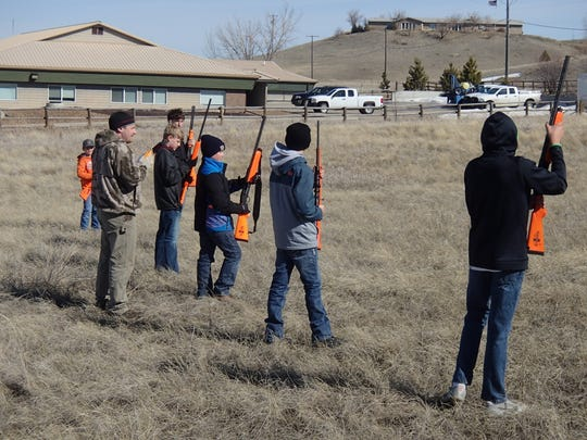 Hunter Ed. students practice hunting upland birds in a field- photo provided by FWP