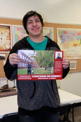 Michael Spearson hopes his poster encourages students who will also be the first high school graduate of their family.