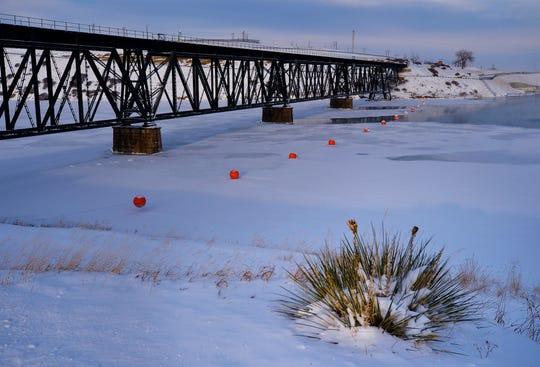 Railroad bridge over the Missouri River at Rainbow Dam, Sunday, February 10, 2019.