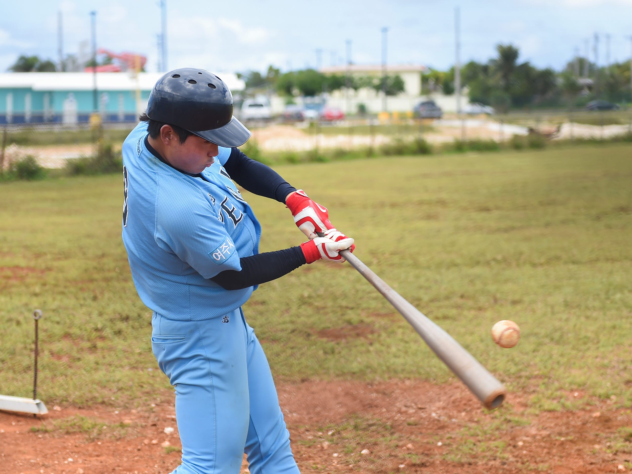 Yeoju University baseball player Ki Young Kwon works on batting during his team's winter training at the Guam Sports Complex in Dededo, Feb. 11, 2019.