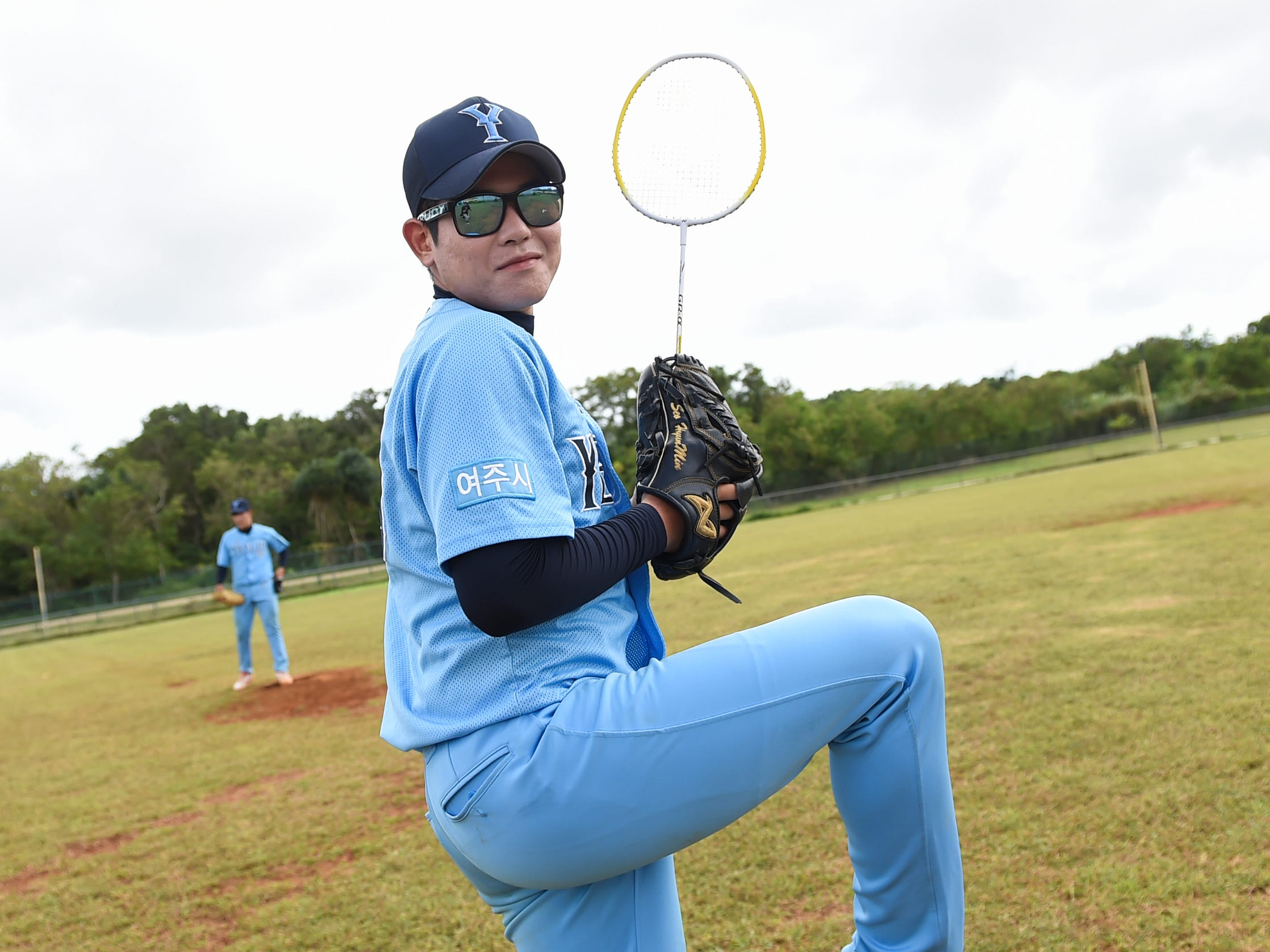 Hyun Min Seo, a Korean baseball player for the Yeoju University team, gives his best pitching pose during a winter training session at the Guam Sports Complex in Dededo, Feb. 11, 2019.