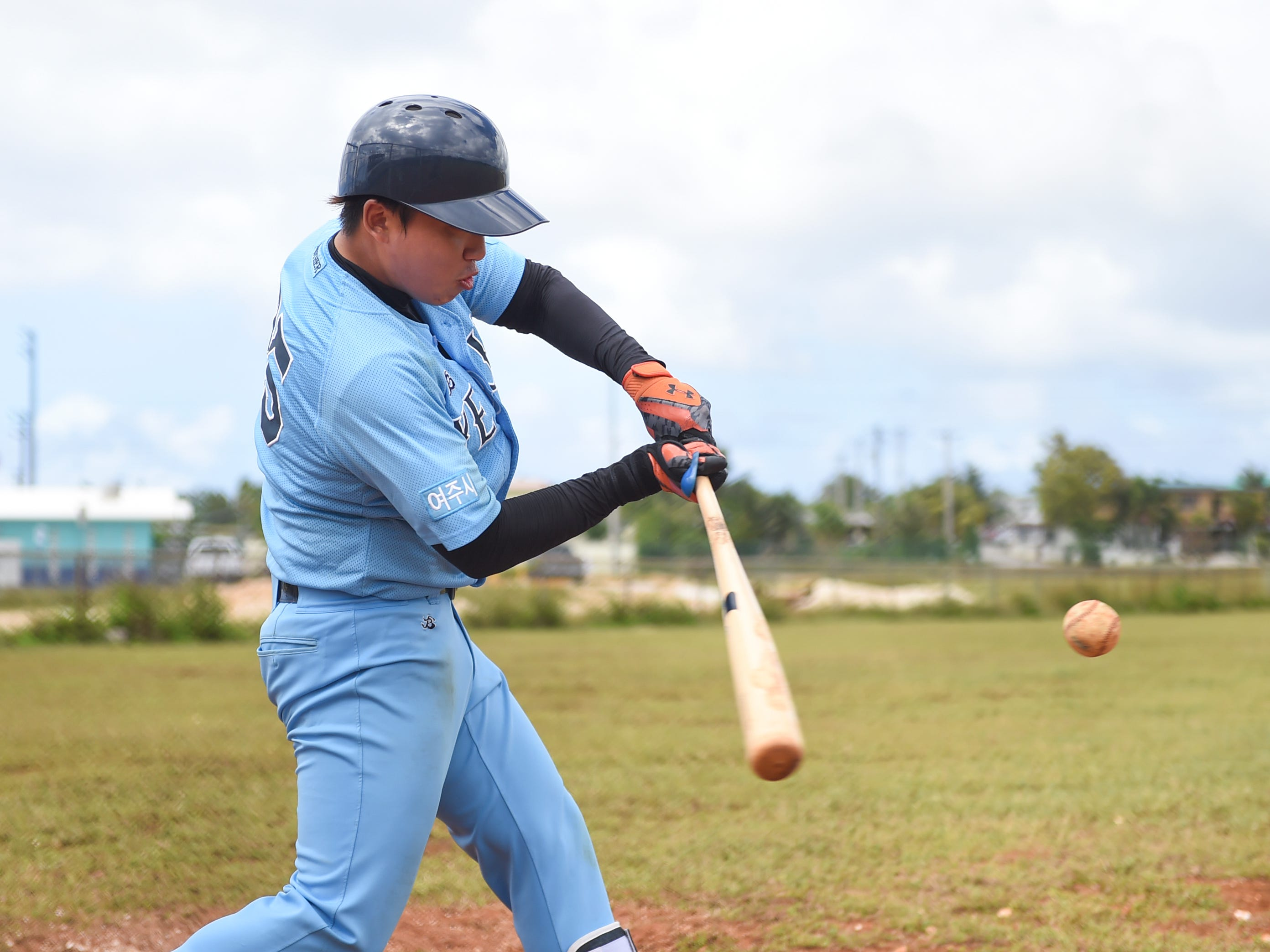 Korean baseball player Kang Un Kim goes through batting drills with during his Yeoju University team's winter training at the Guam Sports Complex in Dededo, Feb. 11, 2019.