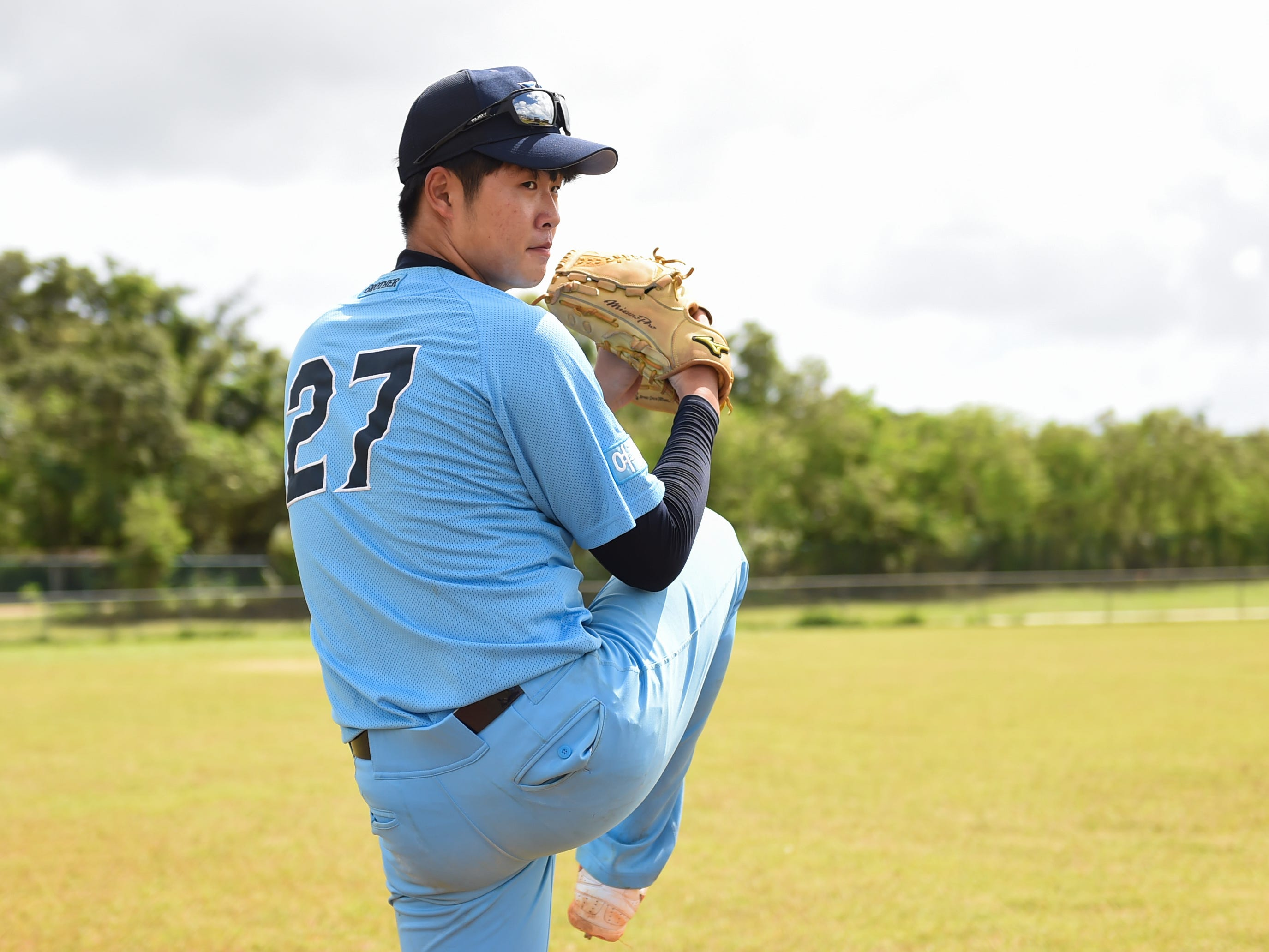 Yeoju University baseball team pitcher Jun Beom Park trains with his team at the Guam Sports Complex in Dededo, Feb. 11, 2019.