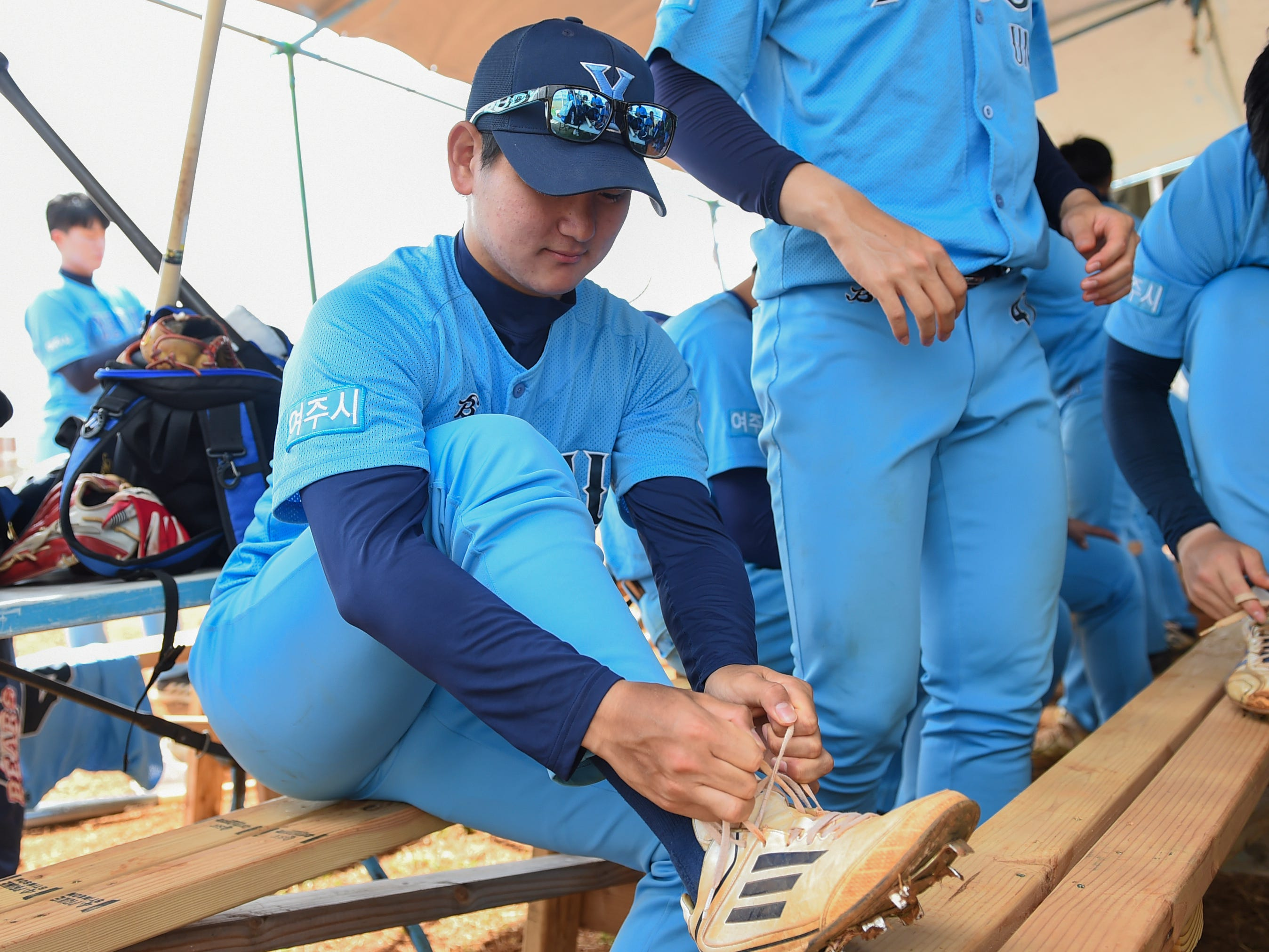 Members of the Yeoju University baseball team prepare for their winter training at the Guam Sports Complex in Dededo, Feb. 11, 2019.