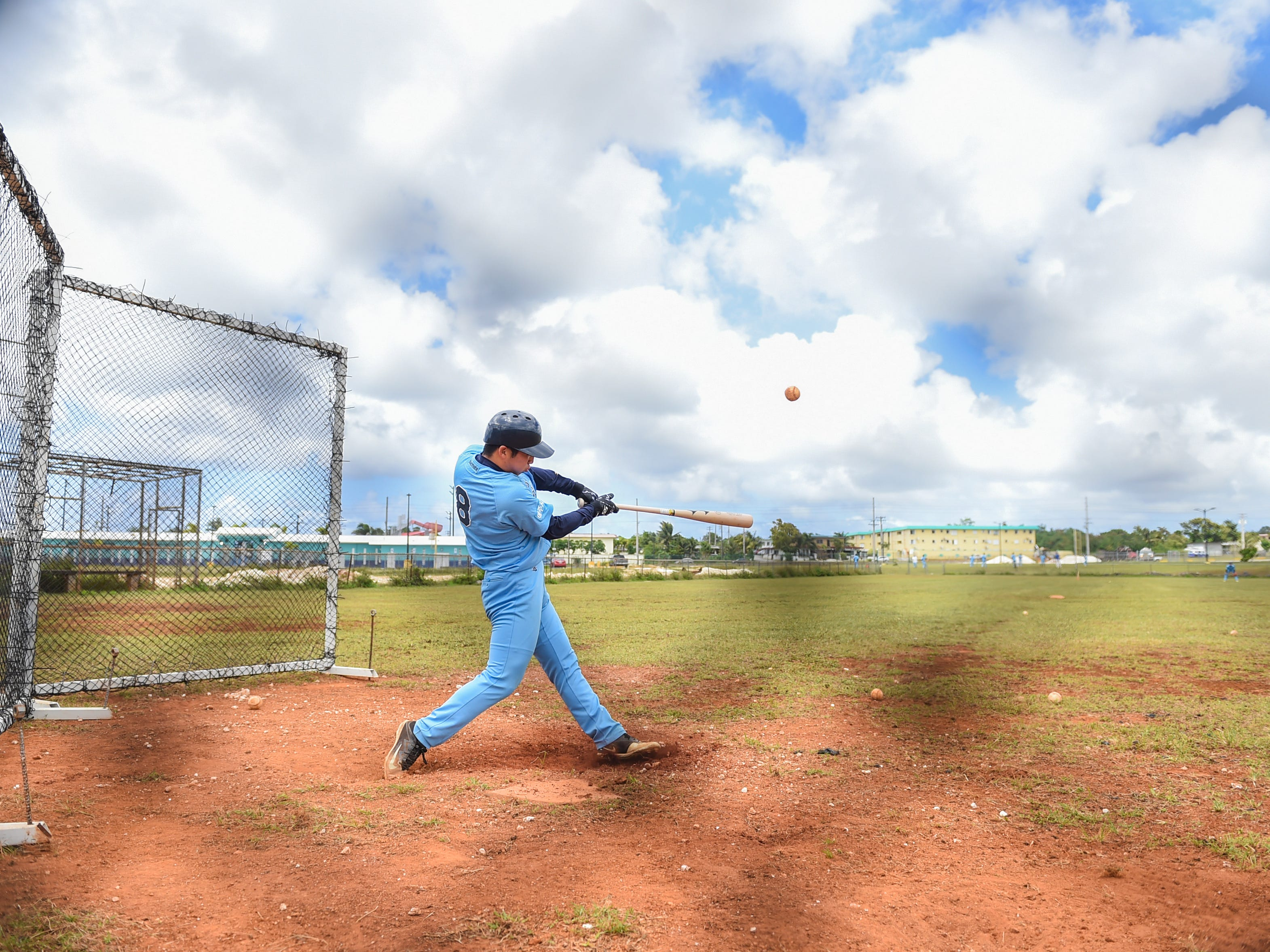 Yeoju University baseball team players get some batting practice in during their winter training at the Guam Sports Complex in Dededo, Feb. 11, 2019.