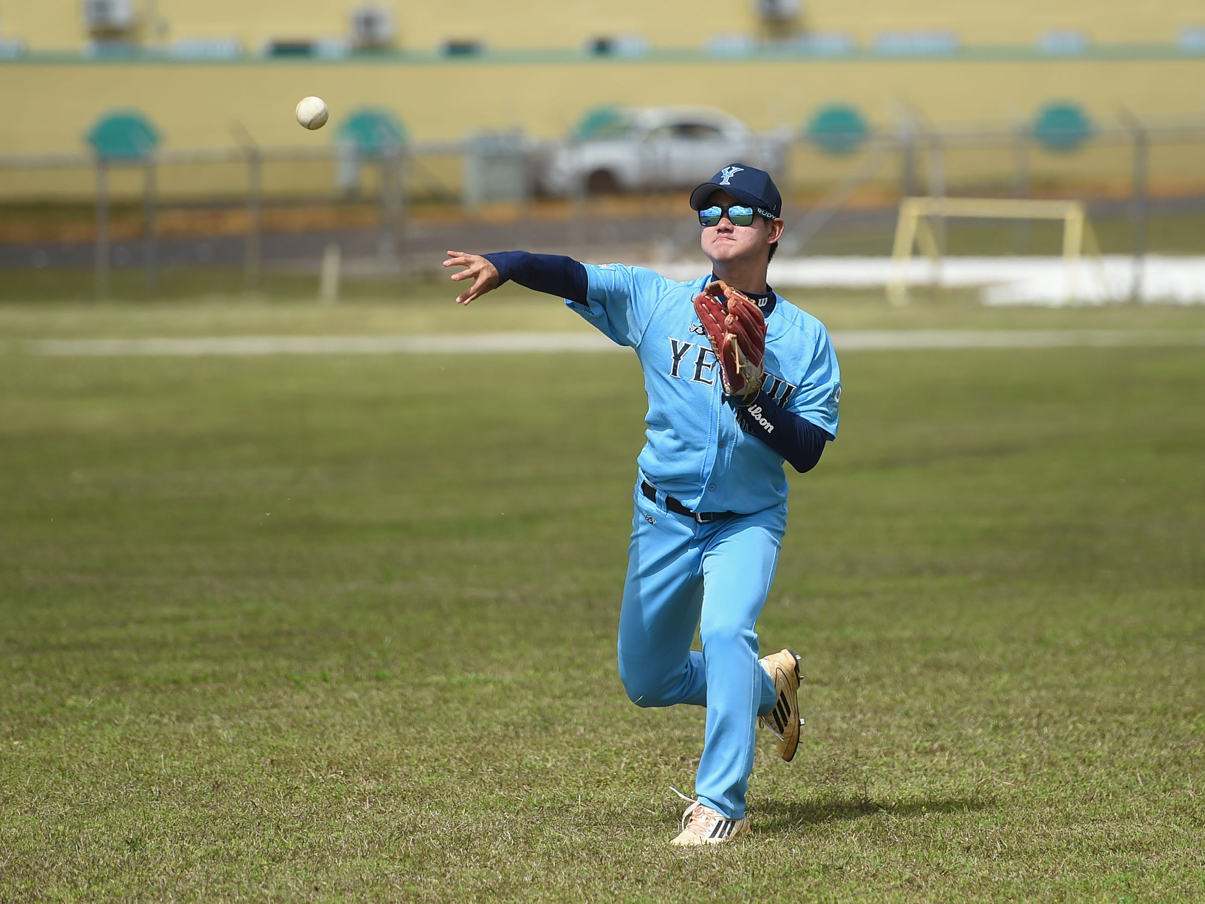 Yeoju University baseball team players work on fielding drills at the Guam Sports Complex in Dededo, Feb. 11, 2019.