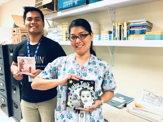 Lee Santos, RN, left, and Leyanne Muna of the Southern Region Community Health Center, accept over 100 books for the Reach out and Read program on behalf of the Rigalu Foundation on Feb. 11.  To date, the Rigalu Foundation has donated over 1,000 books to the program using in-house fundraising and charitable donations.
