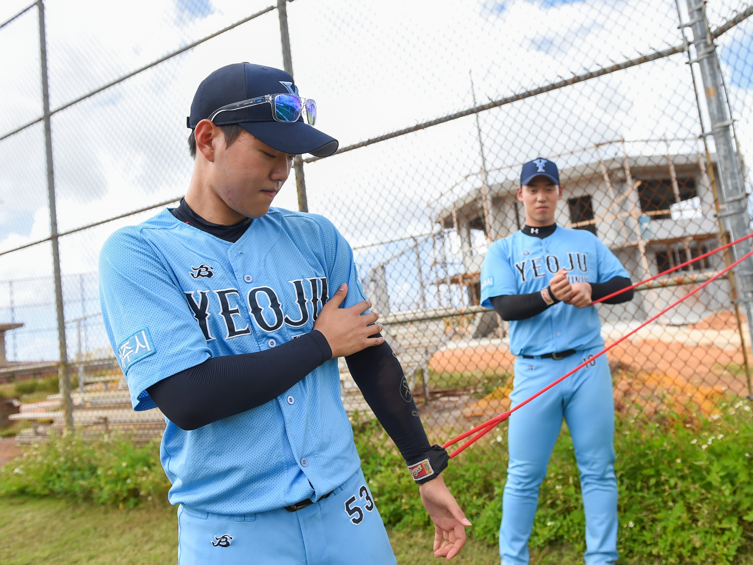 Yeoju University baseball team pitchers train their arms during a practice at the Guam Sports Complex in Dededo, Feb. 11, 2019.