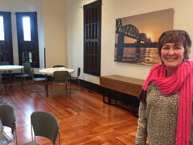 Lisa Fulkerson shows off the main room at the Hoffman House Venue on Second Street.