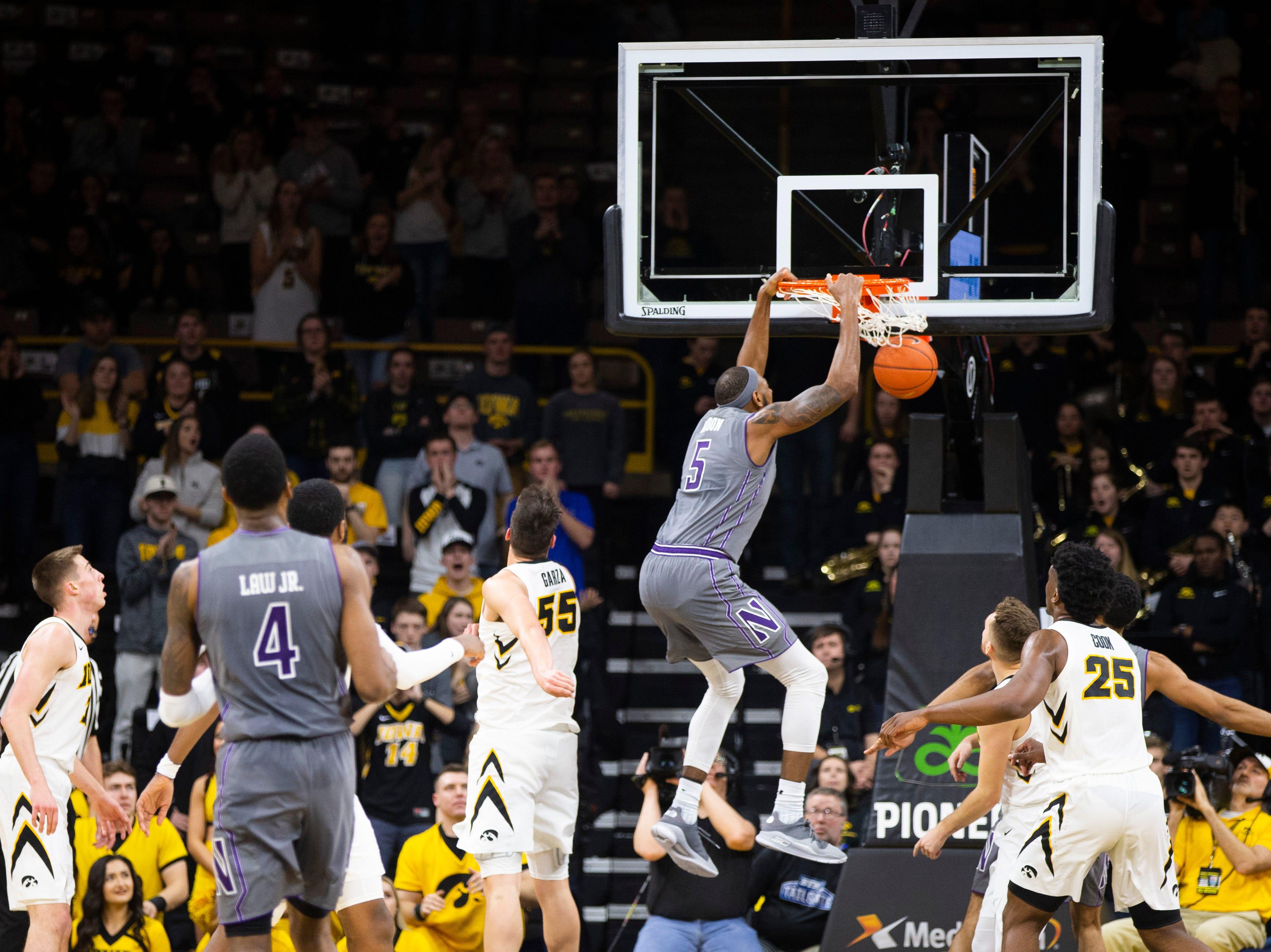 Northwestern center Dererk Pardon (5) dunks during a NCAA Big Ten Conference men's basketball game on Sunday, Feb. 10, 2019 at Carver-Hawkeye Arena in Iowa City, Iowa.