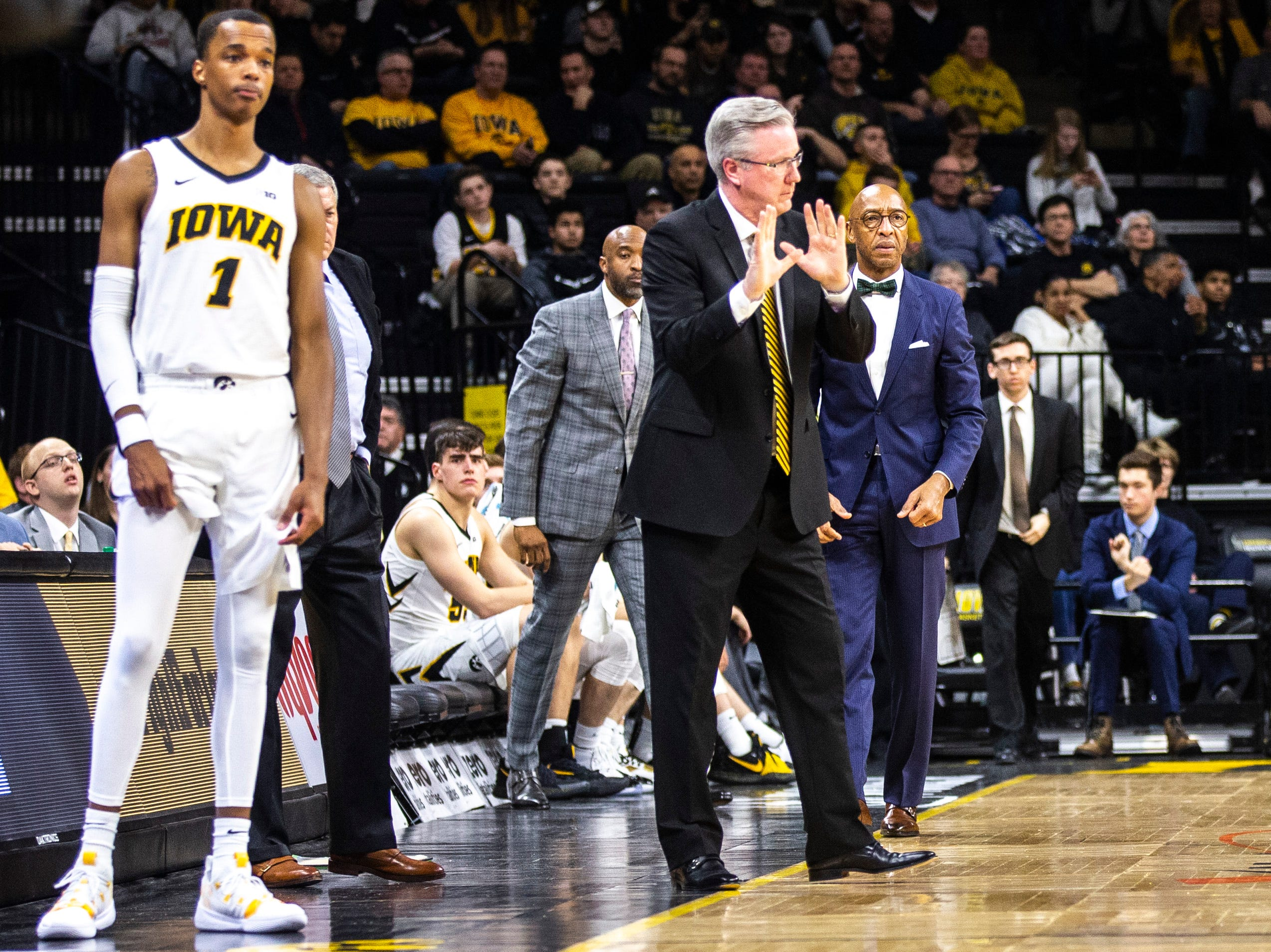 Iowa men's basketball head coach Fran McCaffery reacts to a call while Iowa guard Maishe Dailey (1) looks on during a NCAA Big Ten Conference men's basketball game on Sunday, Feb. 10, 2019 at Carver-Hawkeye Arena in Iowa City, Iowa.