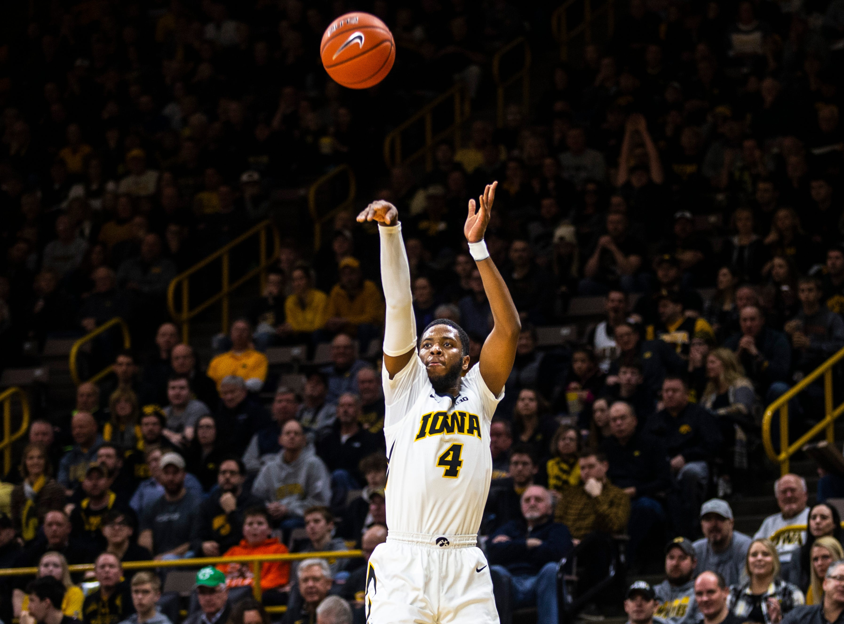 Iowa guard Isaiah Moss (4) shoots a 3-point basket during a NCAA Big Ten Conference men's basketball game on Sunday, Feb. 10, 2019 at Carver-Hawkeye Arena in Iowa City, Iowa.