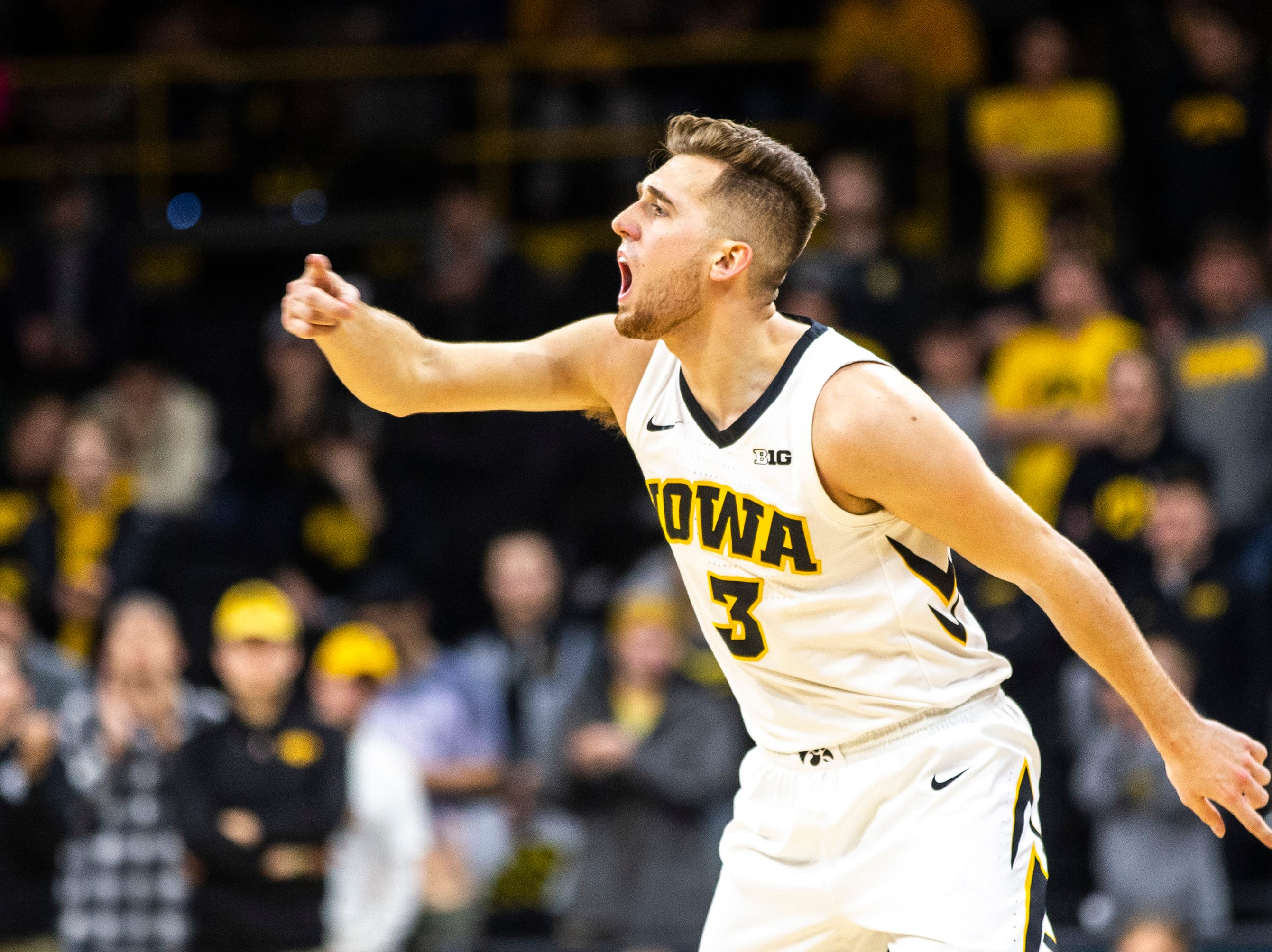 Iowa guard Jordan Bohannon (3) calls out to teammates after making a 3-point basket during a NCAA Big Ten Conference men's basketball game on Sunday, Feb. 10, 2019 at Carver-Hawkeye Arena in Iowa City, Iowa.