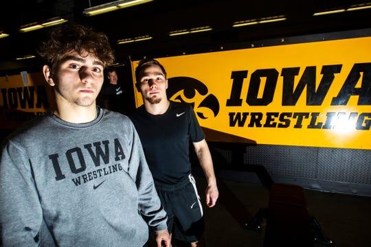 Hawkeyes 133-pounder Austin DeSanto, left, says that Spencer Lee, right, has been a mentor for him since his August arrival in Iowa City. (Fun note: That's Tom Brands poking his head into the photo shoot in the background.)