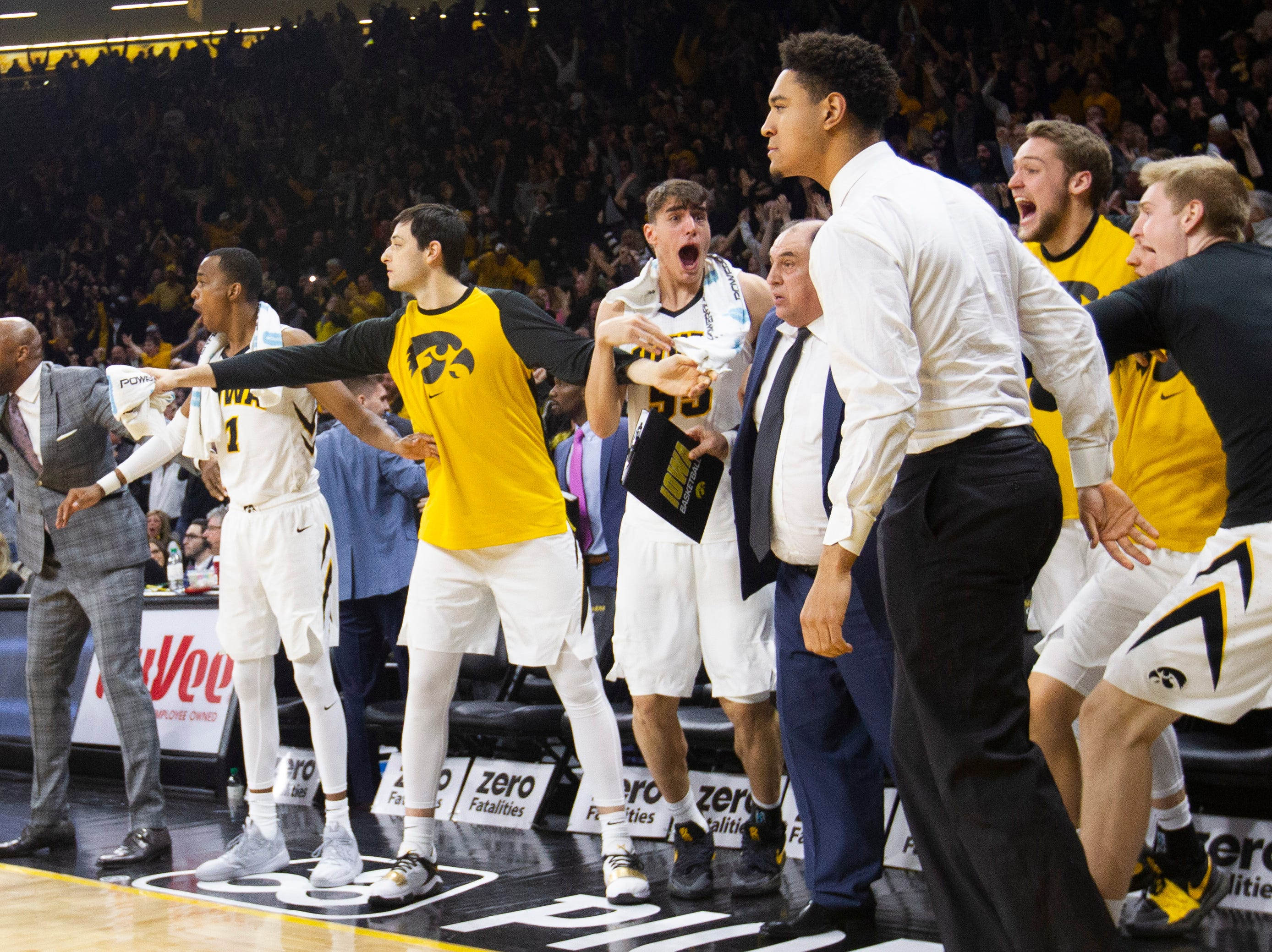 Iowa Hawkeyes bench reacts after Iowa guard Jordan Bohannon (not pictured) made a game-winning 3-point basket during a NCAA Big Ten Conference men's basketball game on Sunday, Feb. 10, 2019 at Carver-Hawkeye Arena in Iowa City, Iowa.