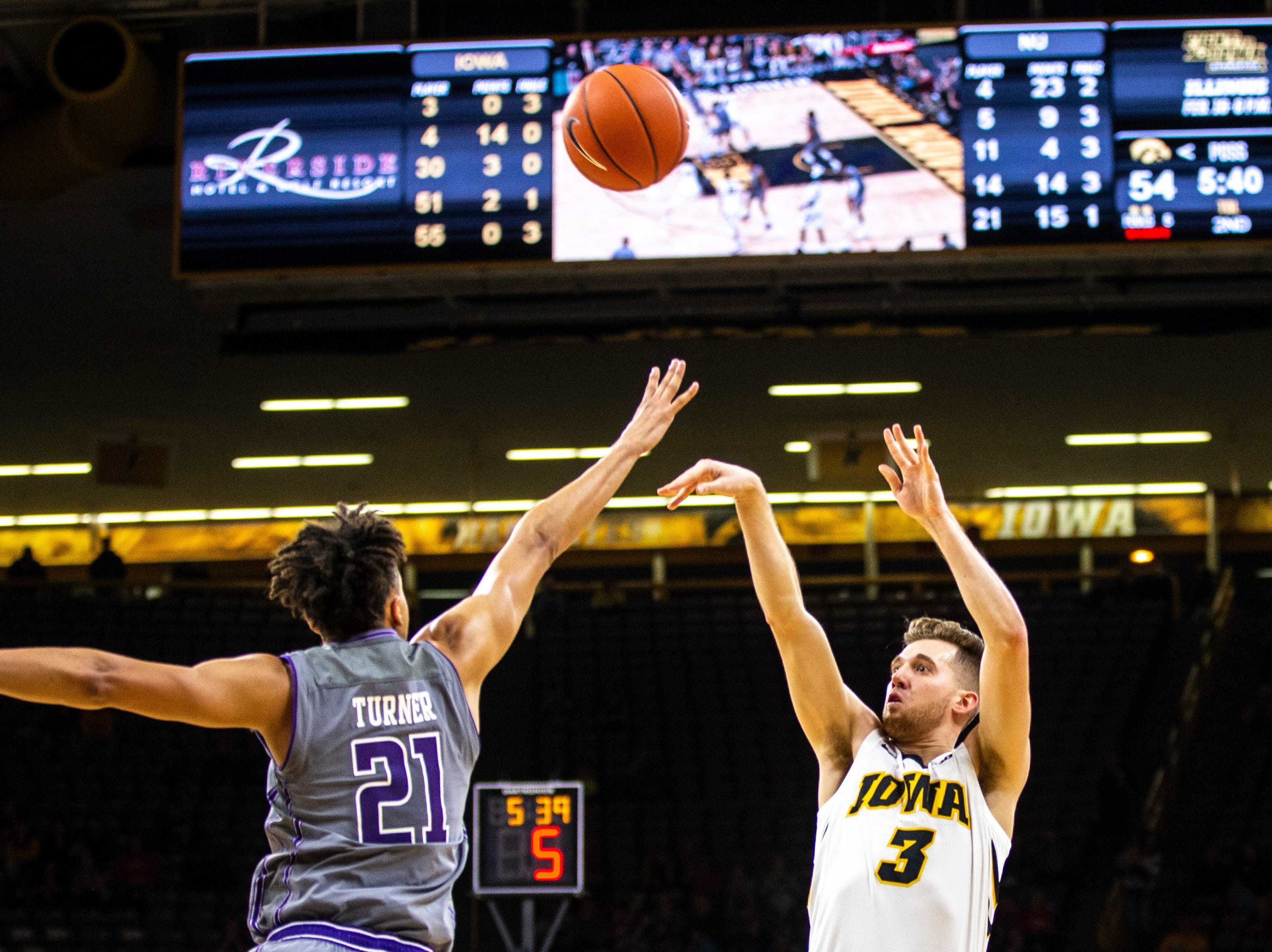 Iowa guard Jordan Bohannon (3) shoots a 3-point basket while Northwestern forward A.J. Turner (21) defends during a NCAA Big Ten Conference men's basketball game on Sunday, Feb. 10, 2019 at Carver-Hawkeye Arena in Iowa City, Iowa.
