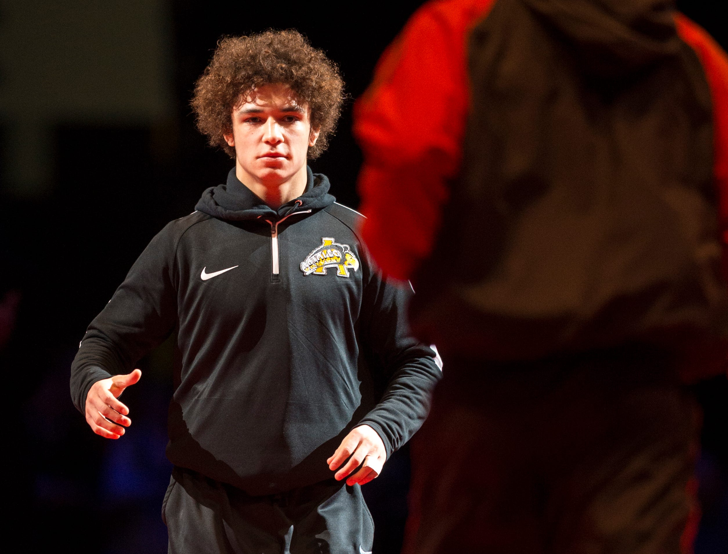 Avon High Schoo's Asa Garcia is introduced during the championship round of the 2018 IHSAA Wrestling State Tournament, Saturday, February 18, 2018, at Bankers Life Fieldhouse in Indianapolis.